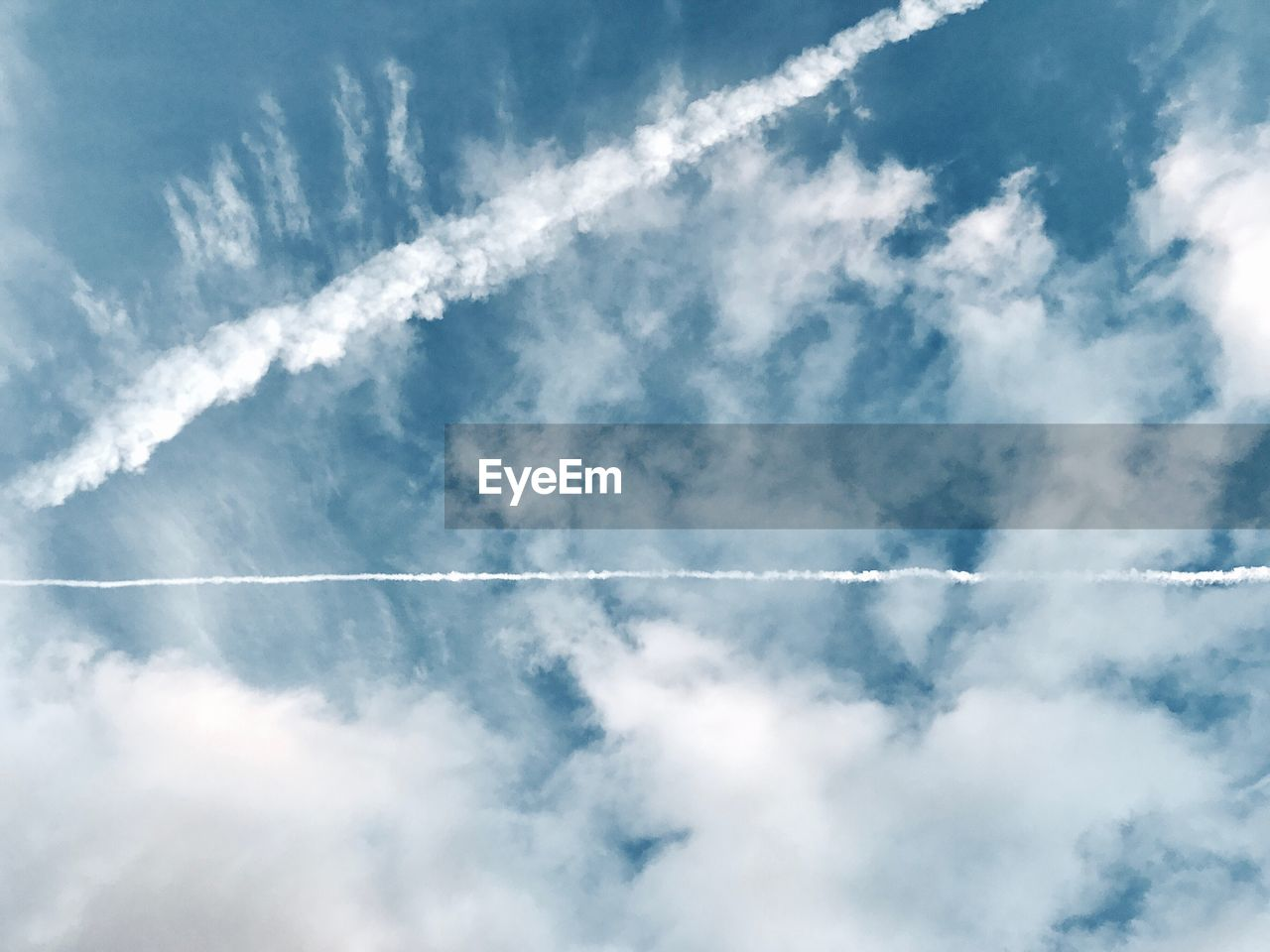 VIEW OF VAPOR TRAIL IN SKY