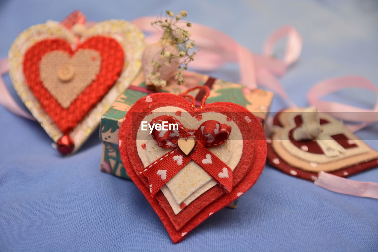 Close-up of heart shape decorations on table