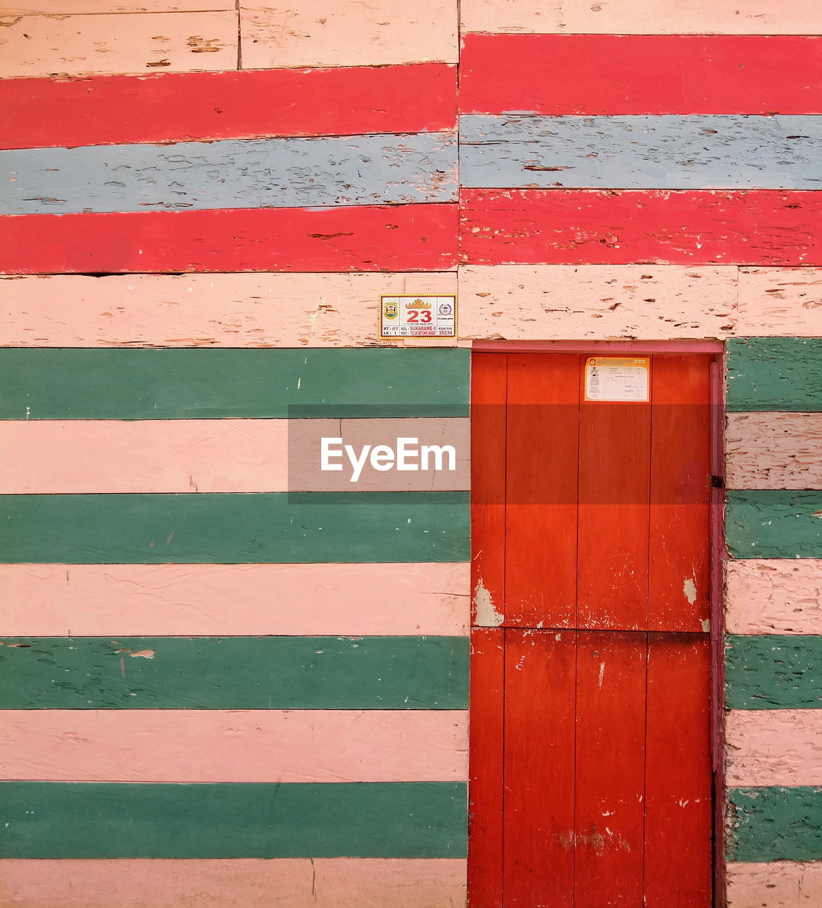 architecture, built structure, wall - building feature, entrance, wood - material, building exterior, red, day, no people, door, closed, outdoors, safety, pattern, protection, multi colored, security, striped, wall, backgrounds