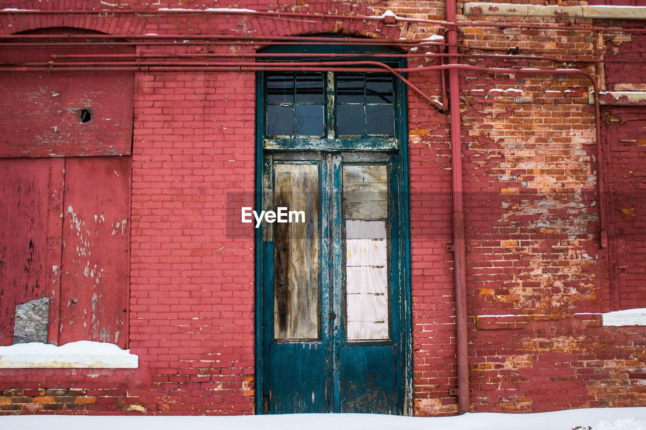Wooden Door And Brick Wall