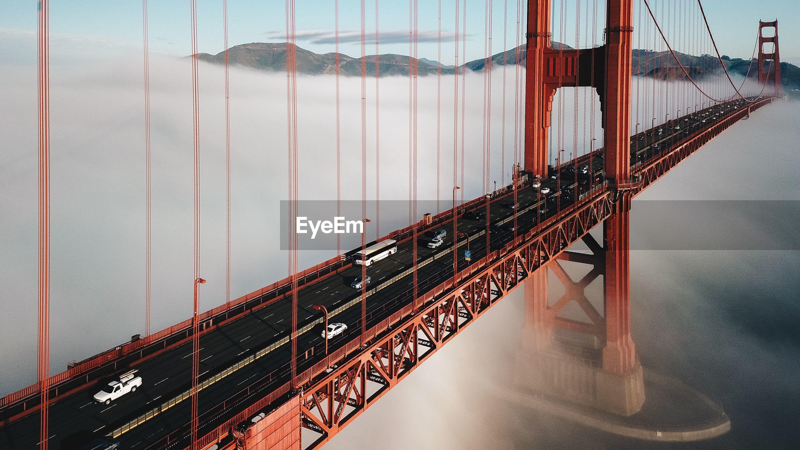 Golden gate bridge over river against sky