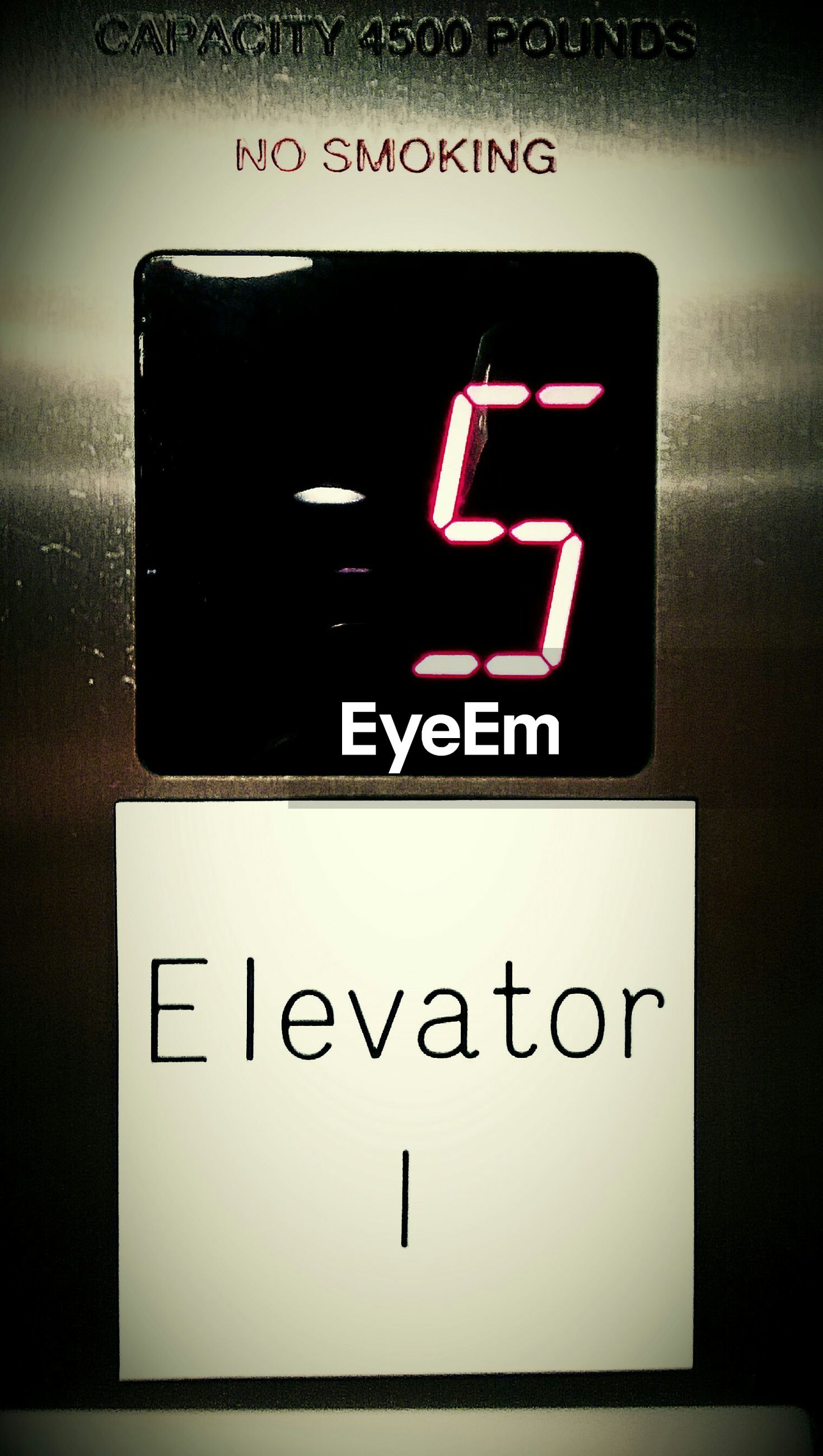 Close-up of text and number in elevator