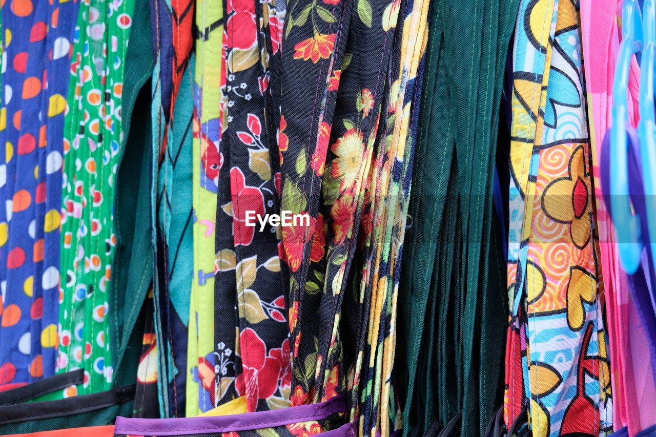 multi colored, textile, variation, choice, no people, pattern, backgrounds, retail, full frame, market, for sale, hanging, art and craft, clothing, store, indoors, retail display, close-up, business, floral pattern, sale, scarf