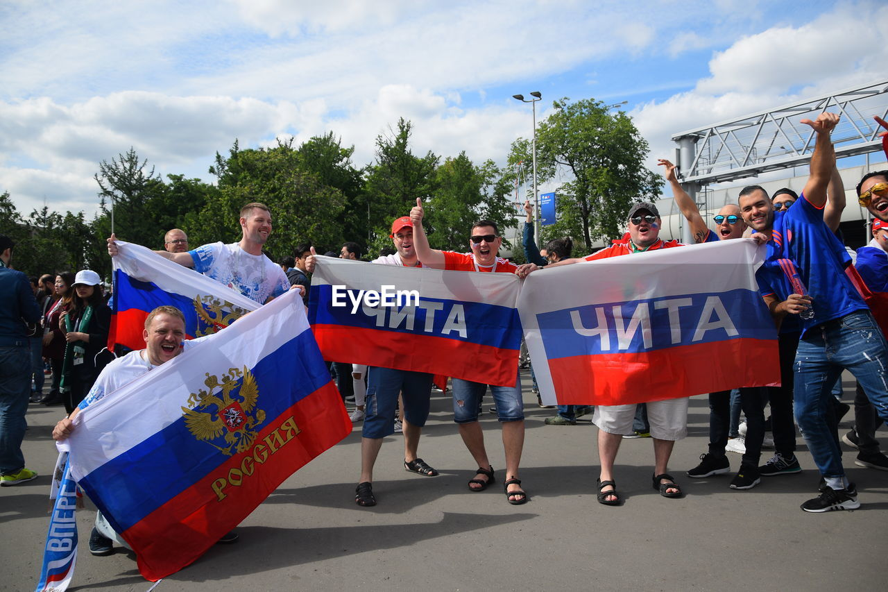 real people, group of people, women, men, adult, flag, crowd, day, people, lifestyles, nature, leisure activity, outdoors, sky, togetherness, patriotism, celebration, blue, protest