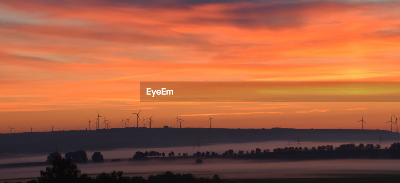 Scenic View Of Windmill Against Sky During Sunset