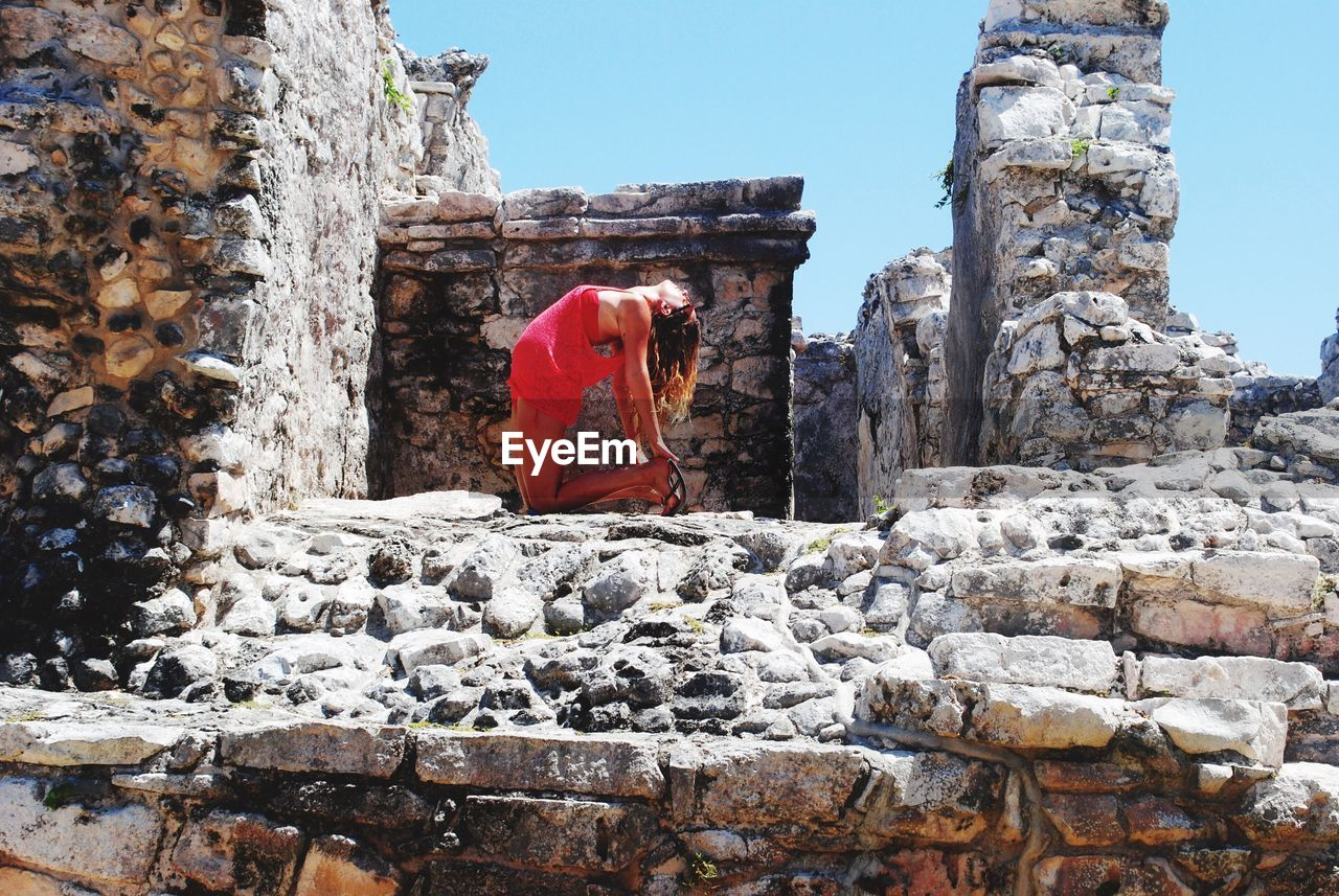 Side View Full Length Of Sensuous Woman Bending At Tulum