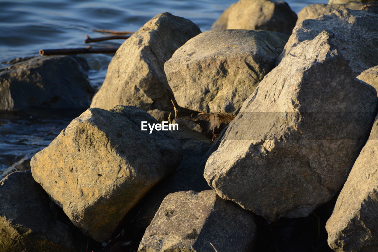 rock - object, water, nature, no people, outdoors, day, tranquility, beach, textured, sea, close-up, pebble beach