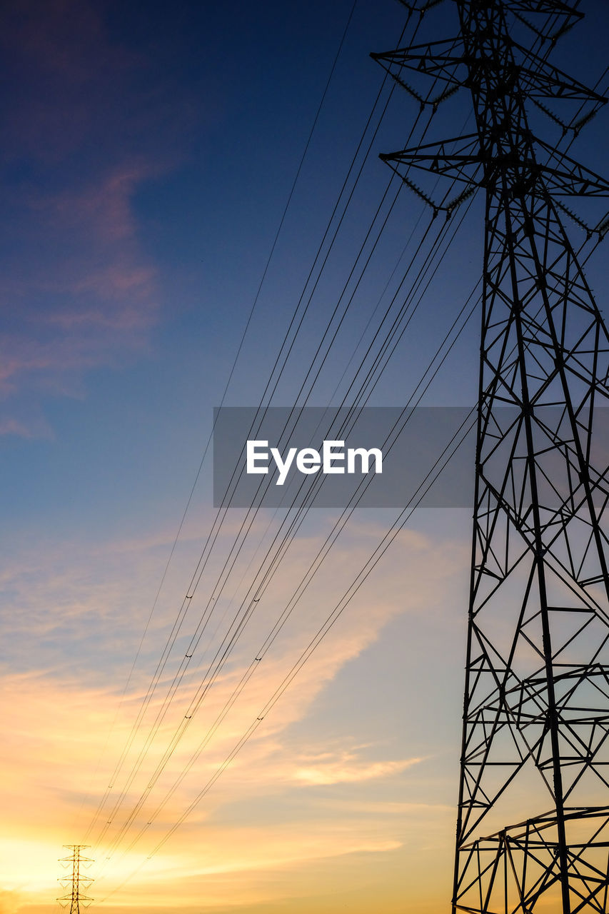 sky, cable, sunset, power line, electricity, low angle view, technology, fuel and power generation, power supply, electricity pylon, cloud - sky, connection, silhouette, no people, nature, orange color, complexity, metal, dusk, built structure, outdoors, electrical equipment, electrical component