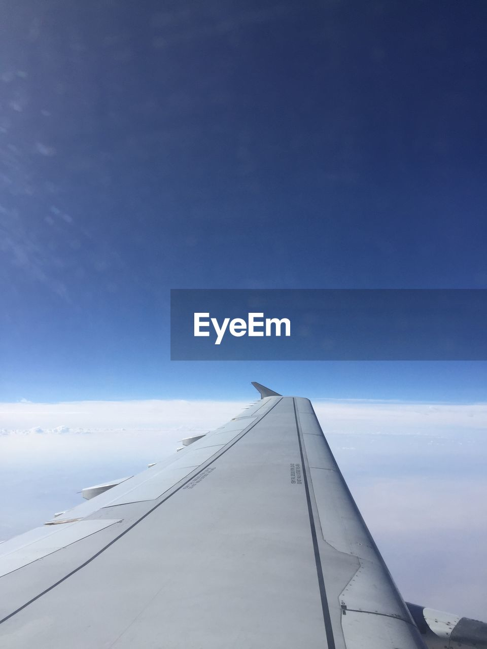 sky, airplane, air vehicle, transportation, aircraft wing, cloud - sky, mode of transportation, flying, blue, nature, no people, motion, vehicle part, travel, mid-air, outdoors, on the move, day, beauty in nature, public transportation, aerospace industry