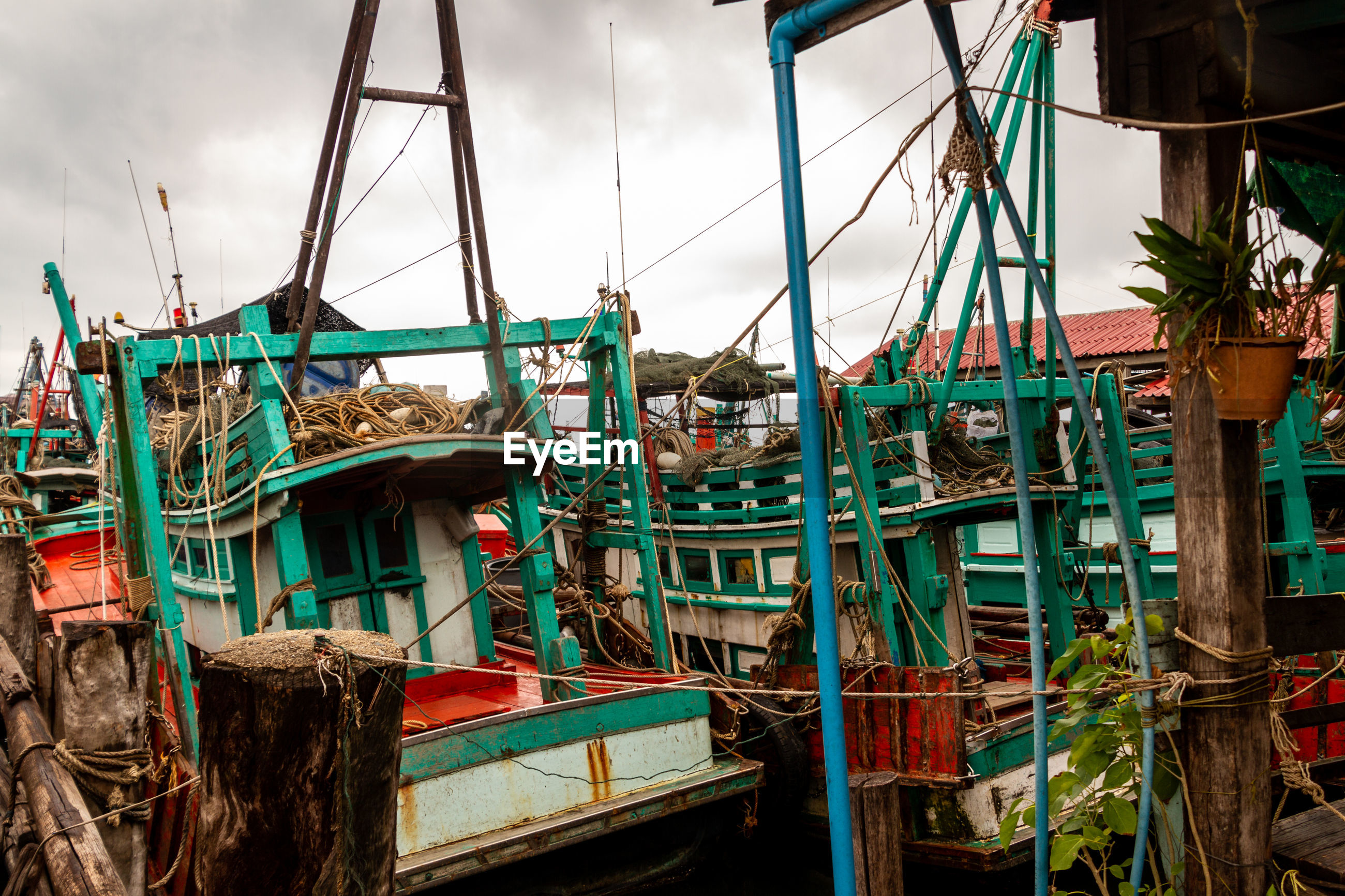 FISHING BOATS MOORED IN WATER