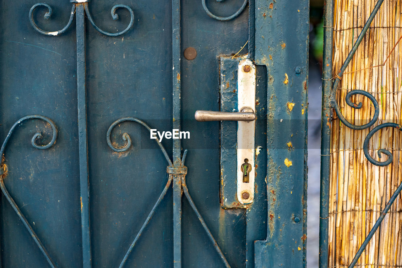metal, no people, close-up, entrance, closed, door, blue, day, full frame, choice, old, variation, wood - material, backgrounds, wall - building feature, outdoors, large group of objects, rusty, architecture, latch