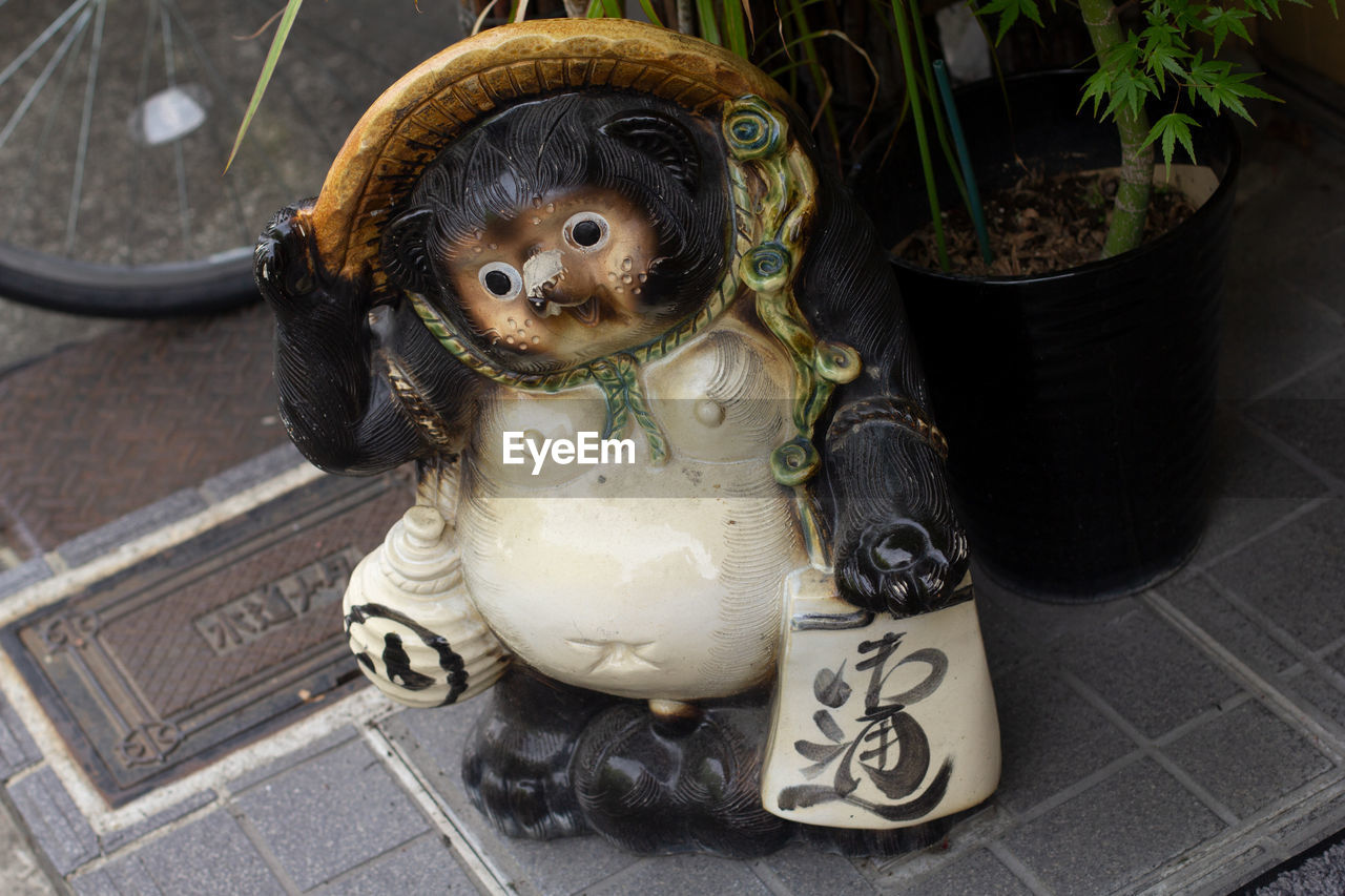 mammal, animal themes, animal, domestic animals, one animal, pets, dog, canine, domestic, no people, potted plant, container, plant, high angle view, animal representation, vertebrate, representation, close-up, indoors, nature, small, flower pot