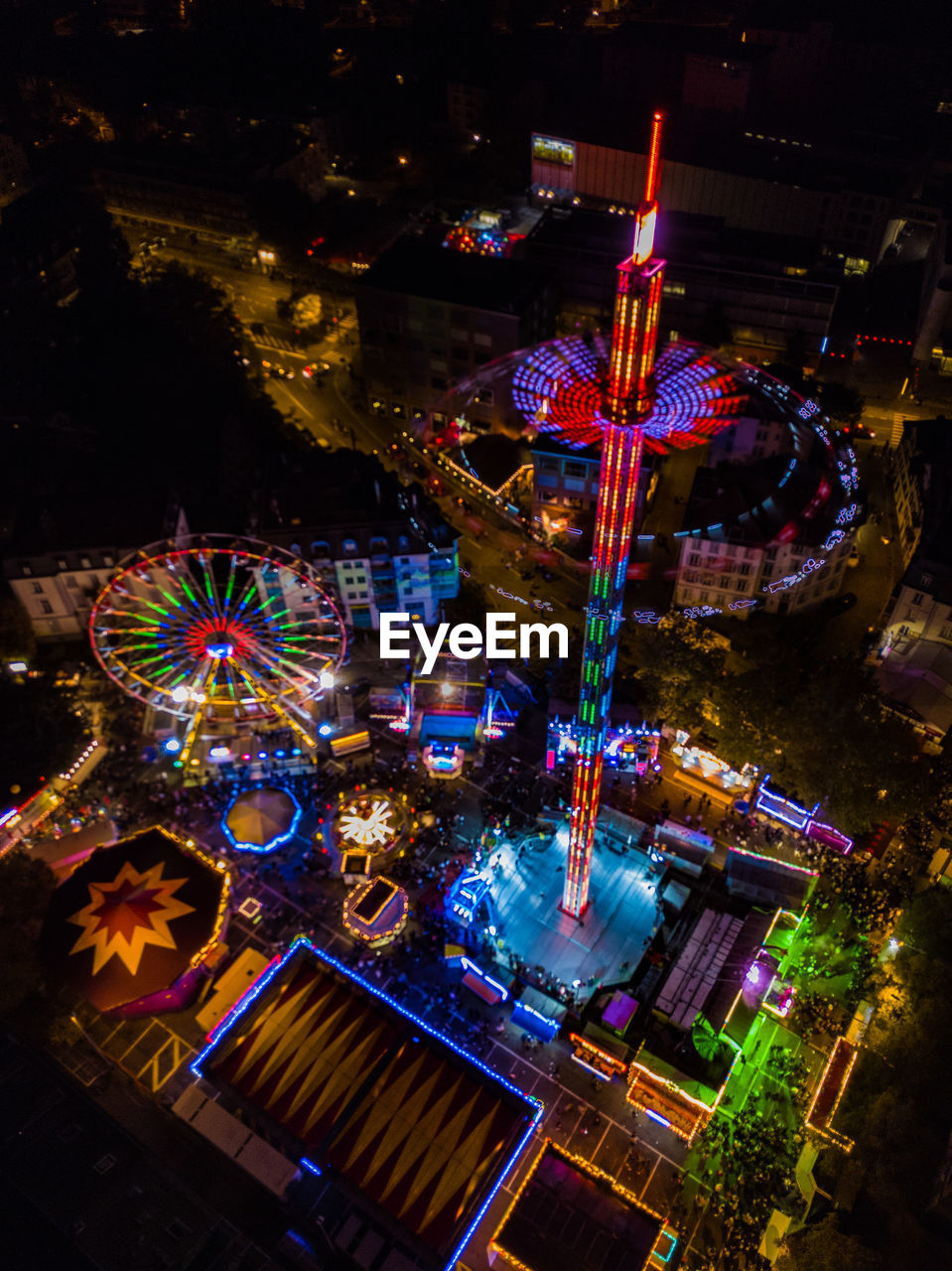 illuminated, night, amusement park, amusement park ride, architecture, built structure, no people, building exterior, arts culture and entertainment, city, glowing, christmas, high angle view, outdoors, multi colored, nature, decoration, candle, celebration, motion, christmas ornament