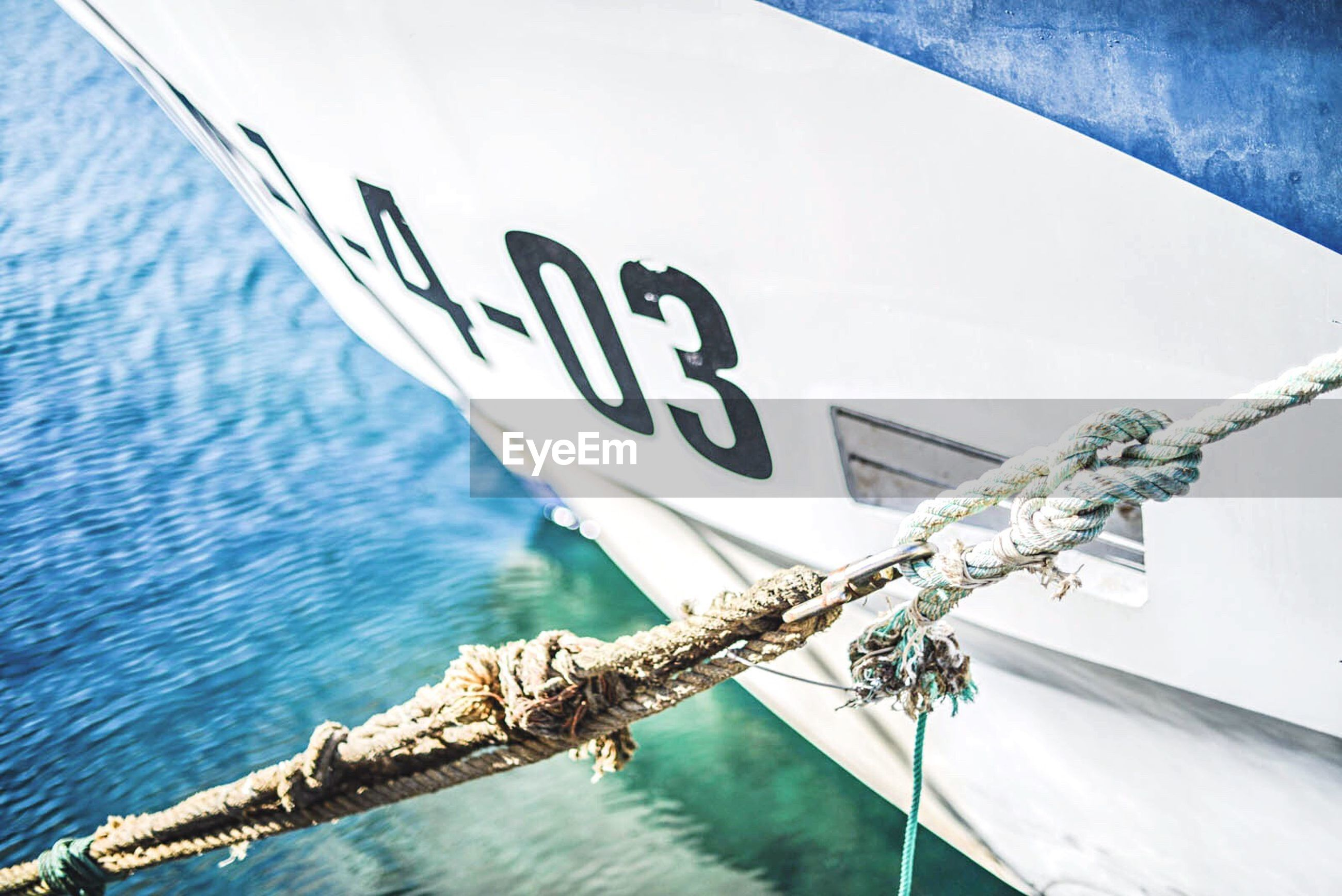 water, nautical vessel, rope, day, text, no people, transportation, outdoors, sea, mode of transport, moored, nature, close-up