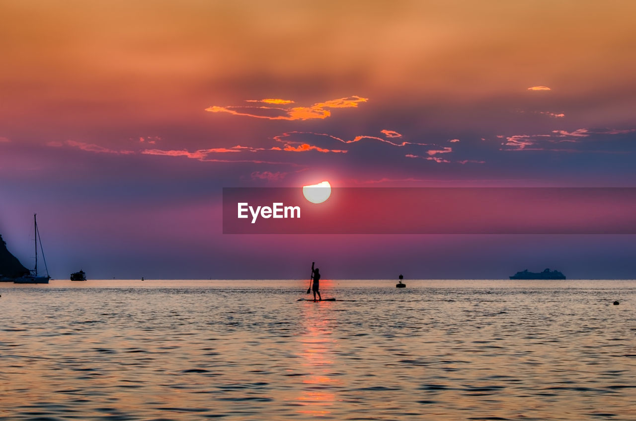 sunset, sky, water, sea, cloud - sky, scenics - nature, beauty in nature, orange color, waterfront, horizon over water, horizon, tranquil scene, nautical vessel, silhouette, tranquility, nature, real people, transportation, idyllic, outdoors