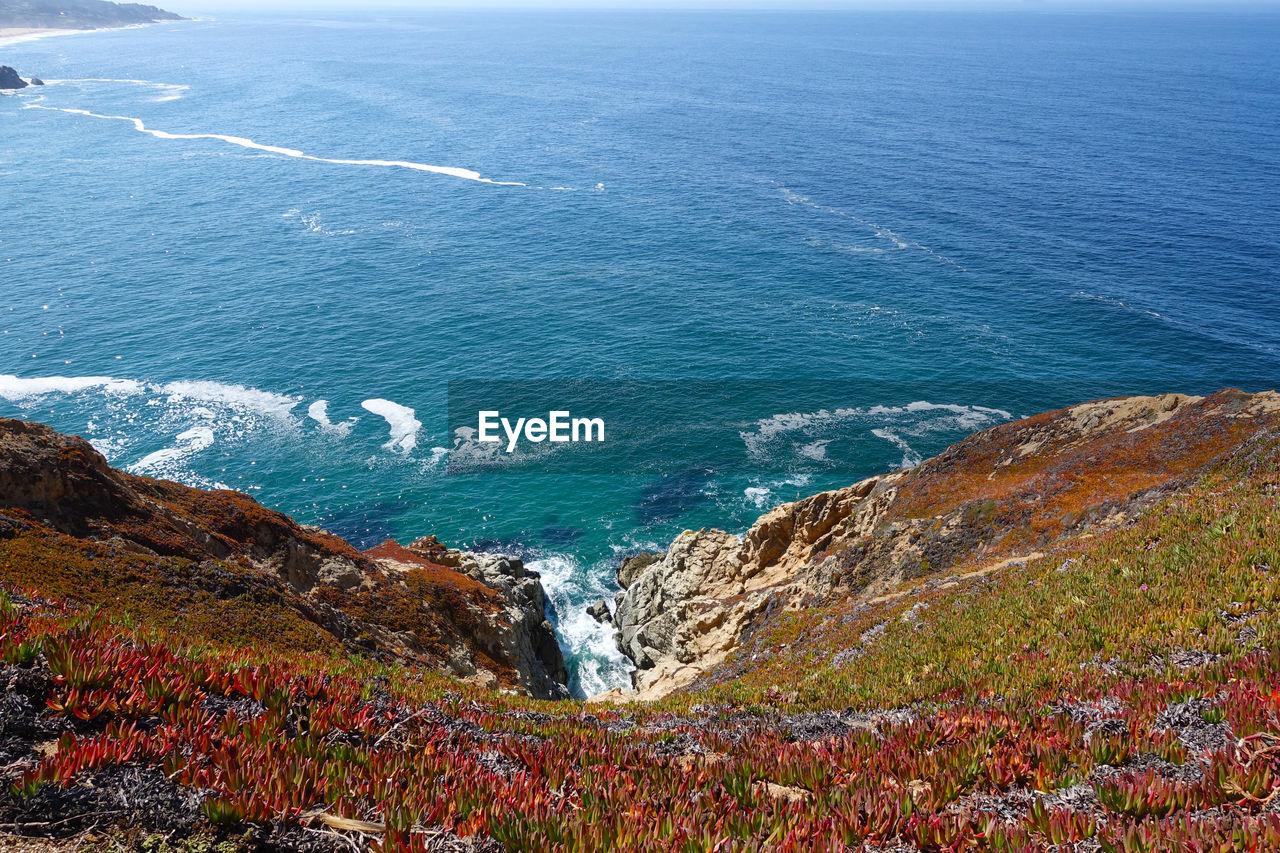 Landscape against calm blue sea