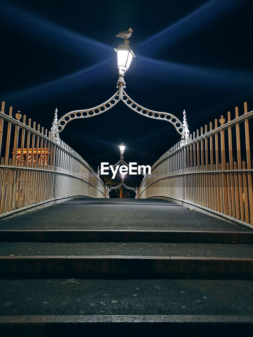 illuminated, night, architecture, built structure, lighting equipment, railing, the way forward, direction, connection, transportation, bridge, bridge - man made structure, no people, glowing, diminishing perspective, light, metal, outdoors, street light, footbridge
