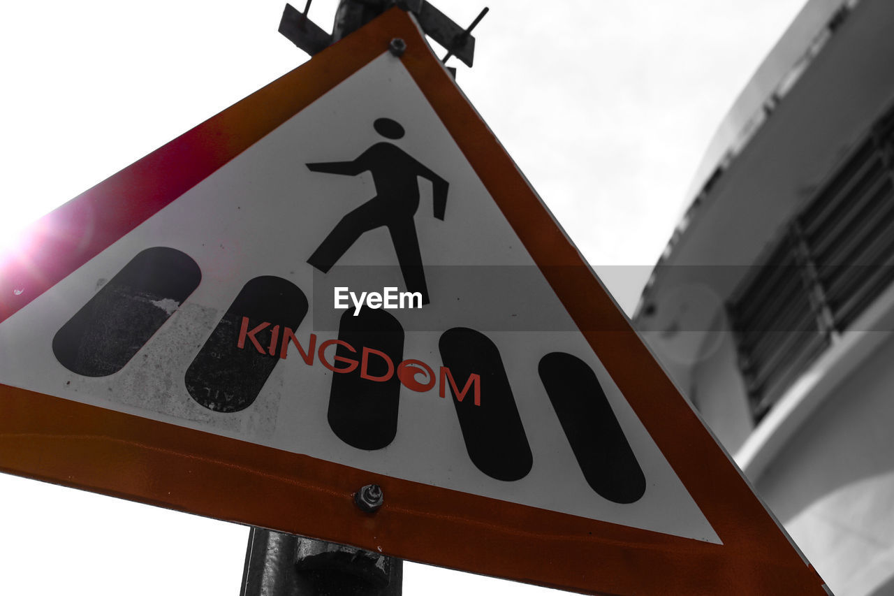 communication, road sign, safety, low angle view, human representation, guidance, day, no people, outdoors, close-up, sky