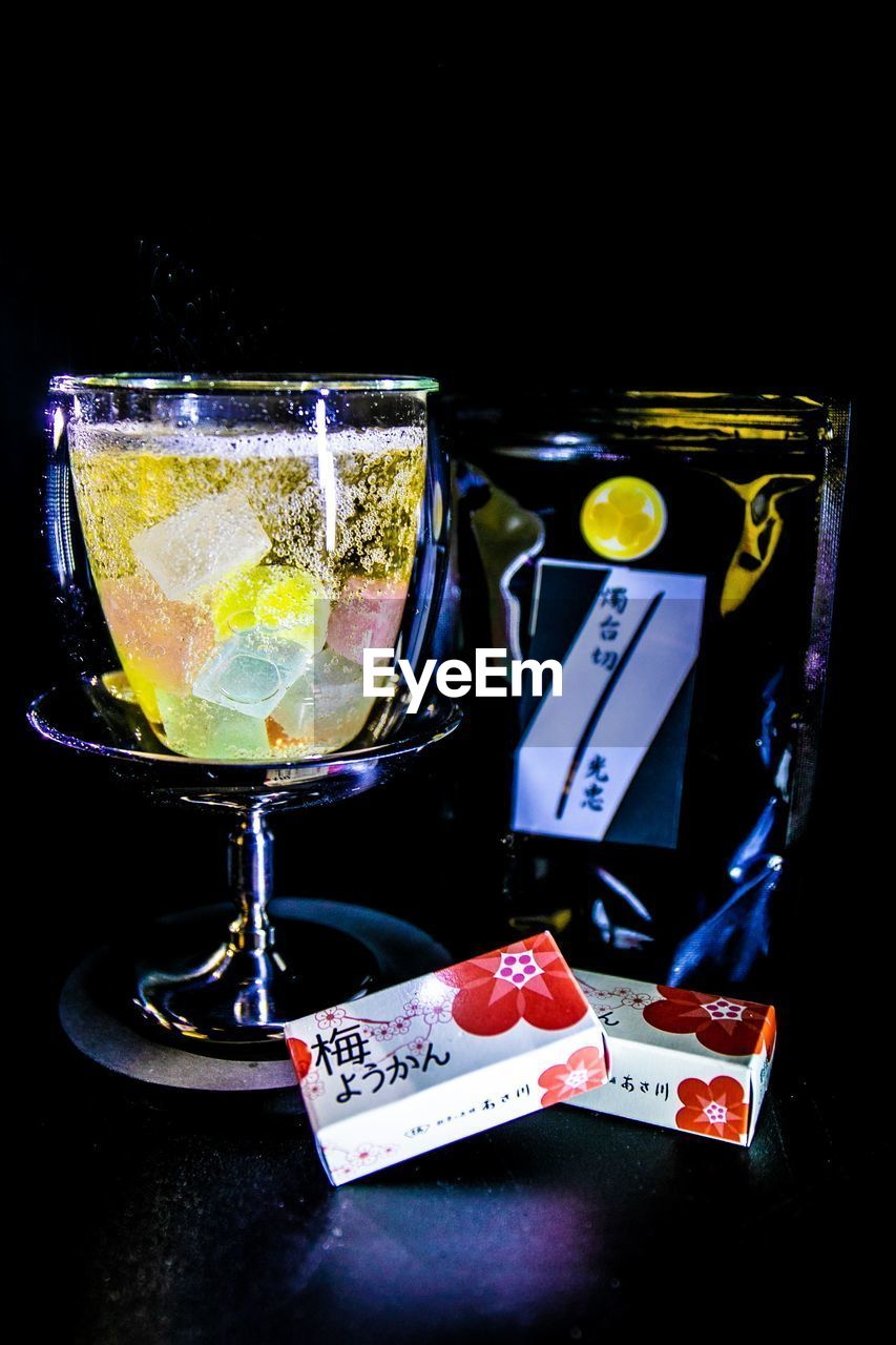 food and drink, drink, refreshment, glass, alcohol, food, fruit, still life, household equipment, citrus fruit, indoors, no people, close-up, freshness, table, drinking glass, black background, cocktail, lemon, healthy eating, tray
