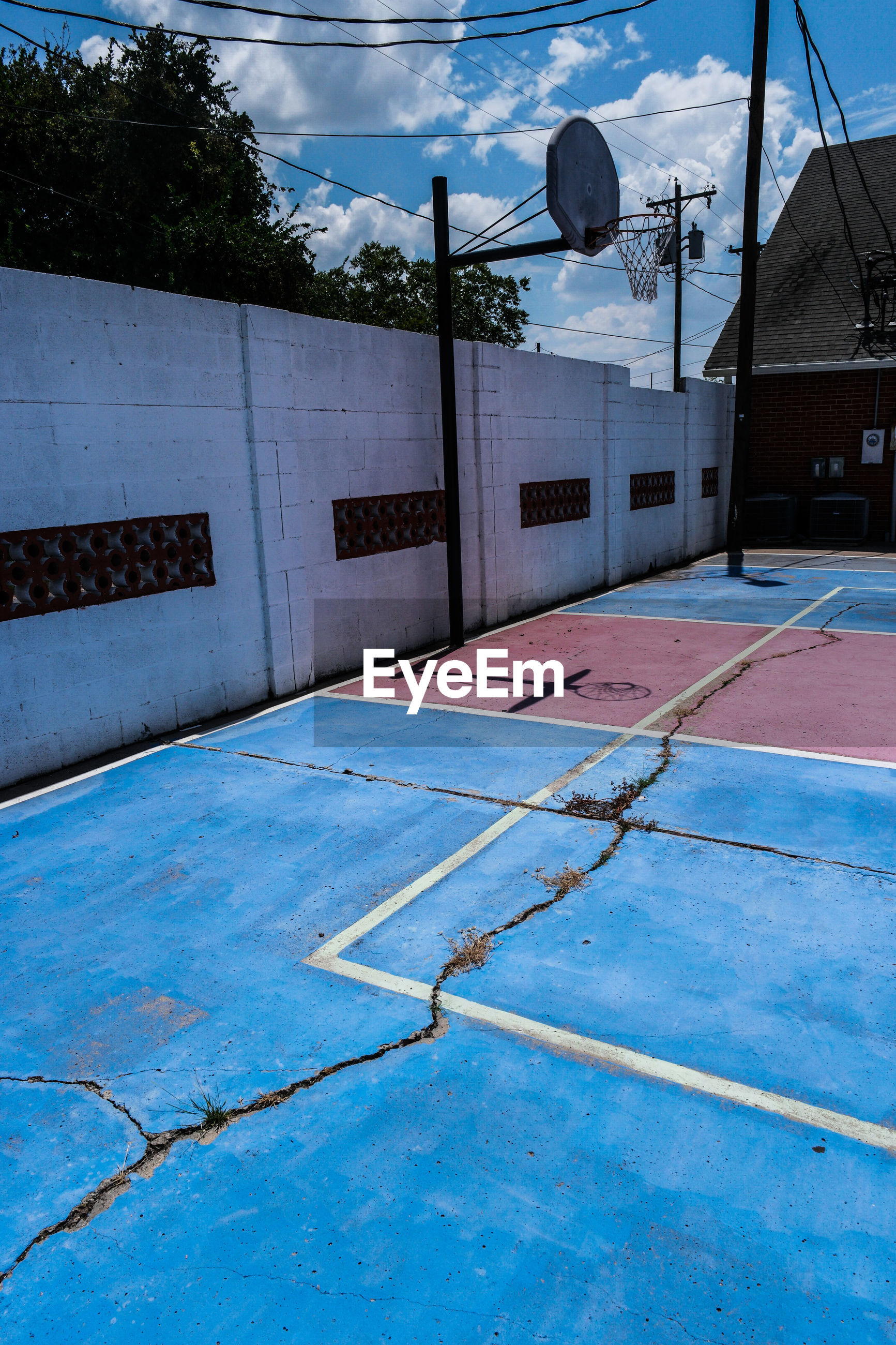 High angle view of cracked basketball court