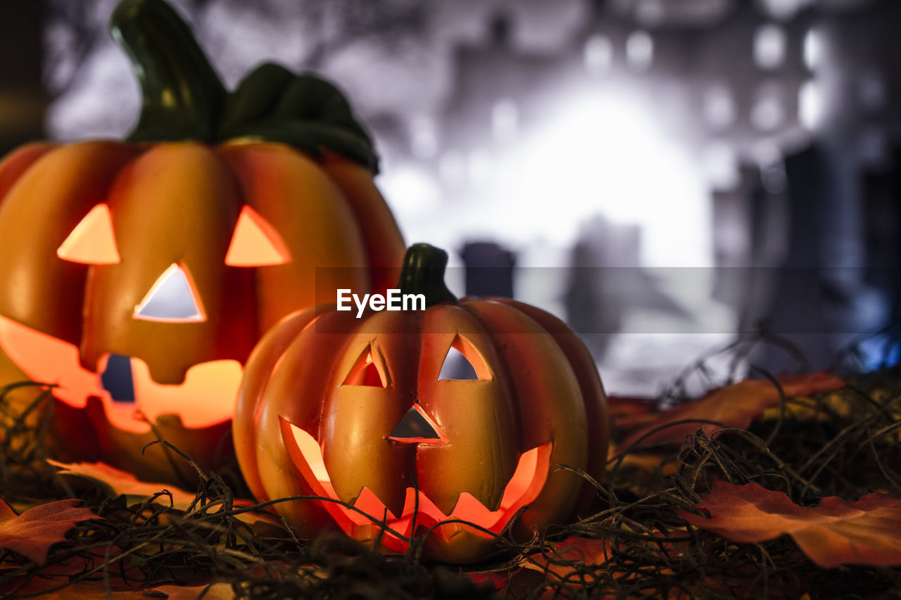 celebration, halloween, jack o' lantern, food, pumpkin, food and drink, illuminated, anthropomorphic face, art and craft, face, creativity, craft, focus on foreground, holiday - event, anthropomorphic, lighting equipment, no people, orange color