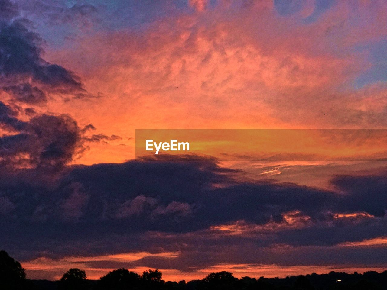 sunset, beauty in nature, nature, sky, dramatic sky, scenics, tranquil scene, tranquility, orange color, cloud - sky, silhouette, idyllic, atmospheric mood, low angle view, no people, sky only, outdoors, backgrounds, awe, day