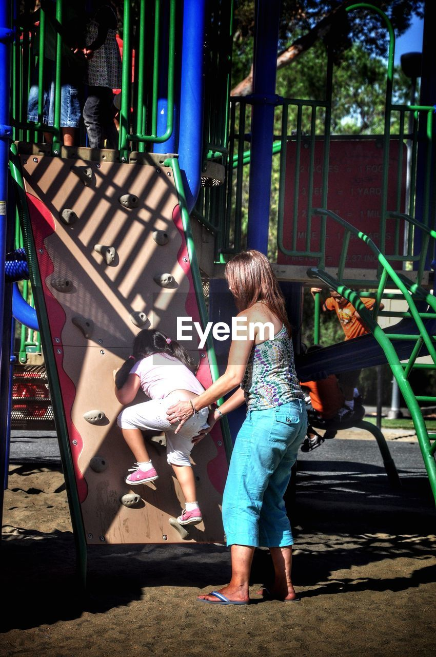 childhood, full length, two people, real people, girls, playground, leisure activity, togetherness, casual clothing, elementary age, boys, playing, day, outdoors, lifestyles, bonding, people