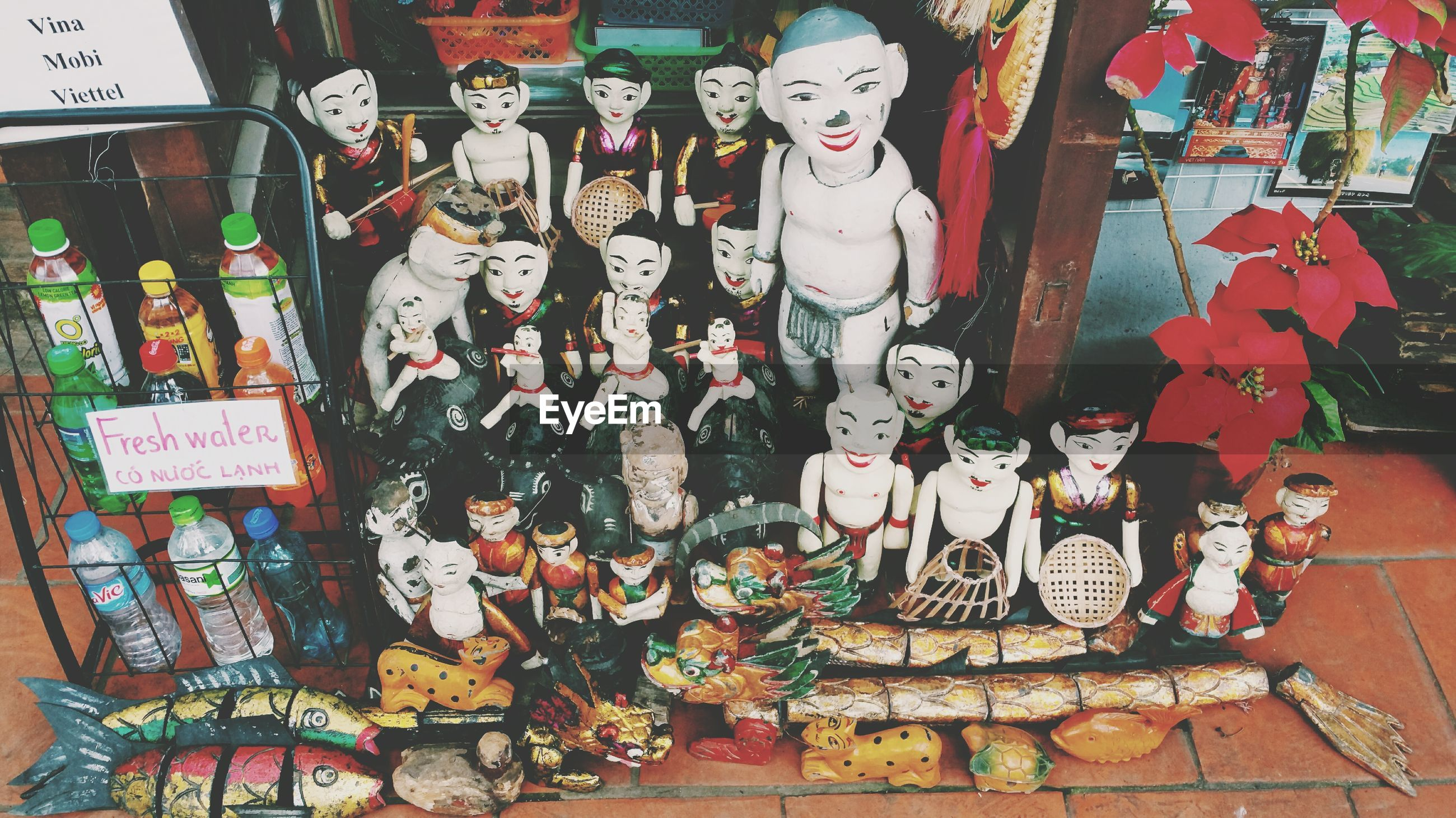 High angle view of dolls for sale at market