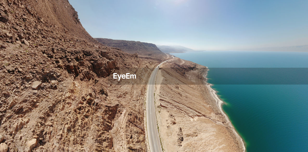Aerial view from the main road along the dead sea, close to the rocks of the ascending mountains