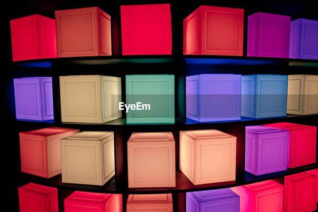 multi colored, shape, in a row, stack, toy block, variation, abstract, red, no people, indoors, day