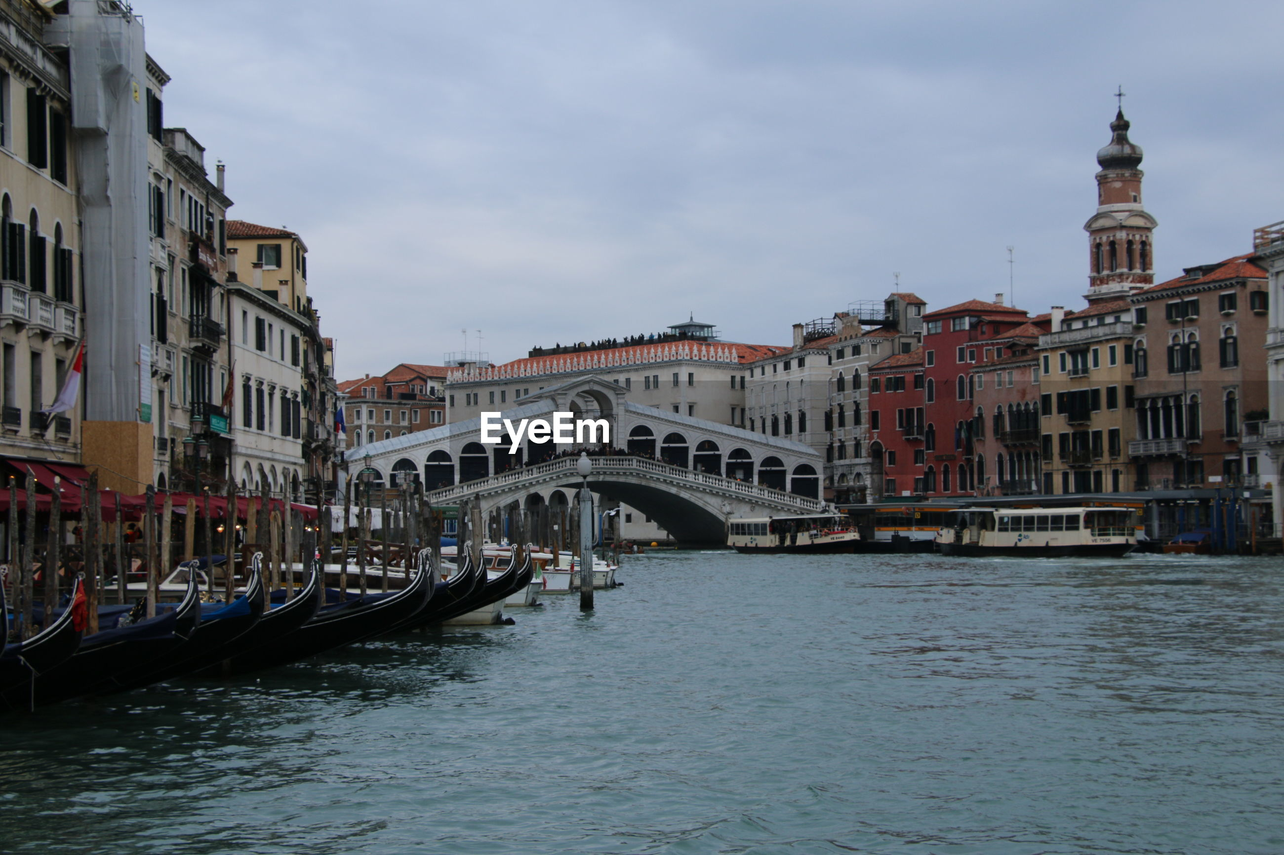 architecture, building exterior, cultures, built structure, travel destinations, canal, travel, bridge - man made structure, water, transportation, tourism, gondola - traditional boat, sky, nautical vessel, city, outdoors, no people, gondolier, day
