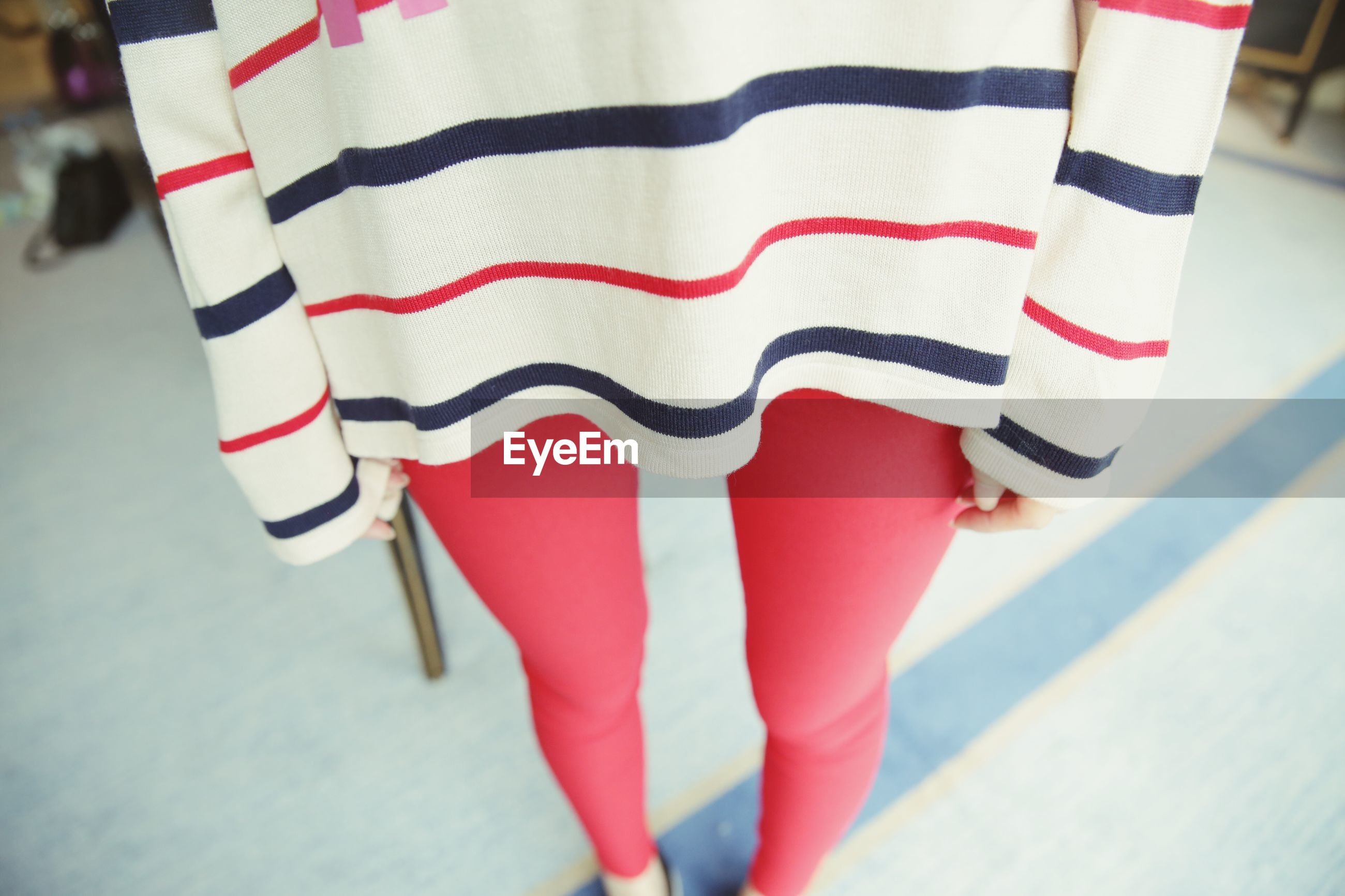 indoors, textile, red, clothing, fabric, low section, multi colored, striped, close-up, person, fashion, white color, pattern, focus on foreground, high angle view, sock, hanging