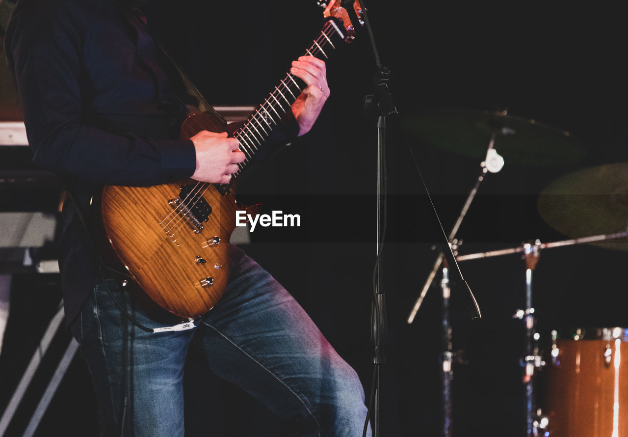 Man playing guitar at music concert