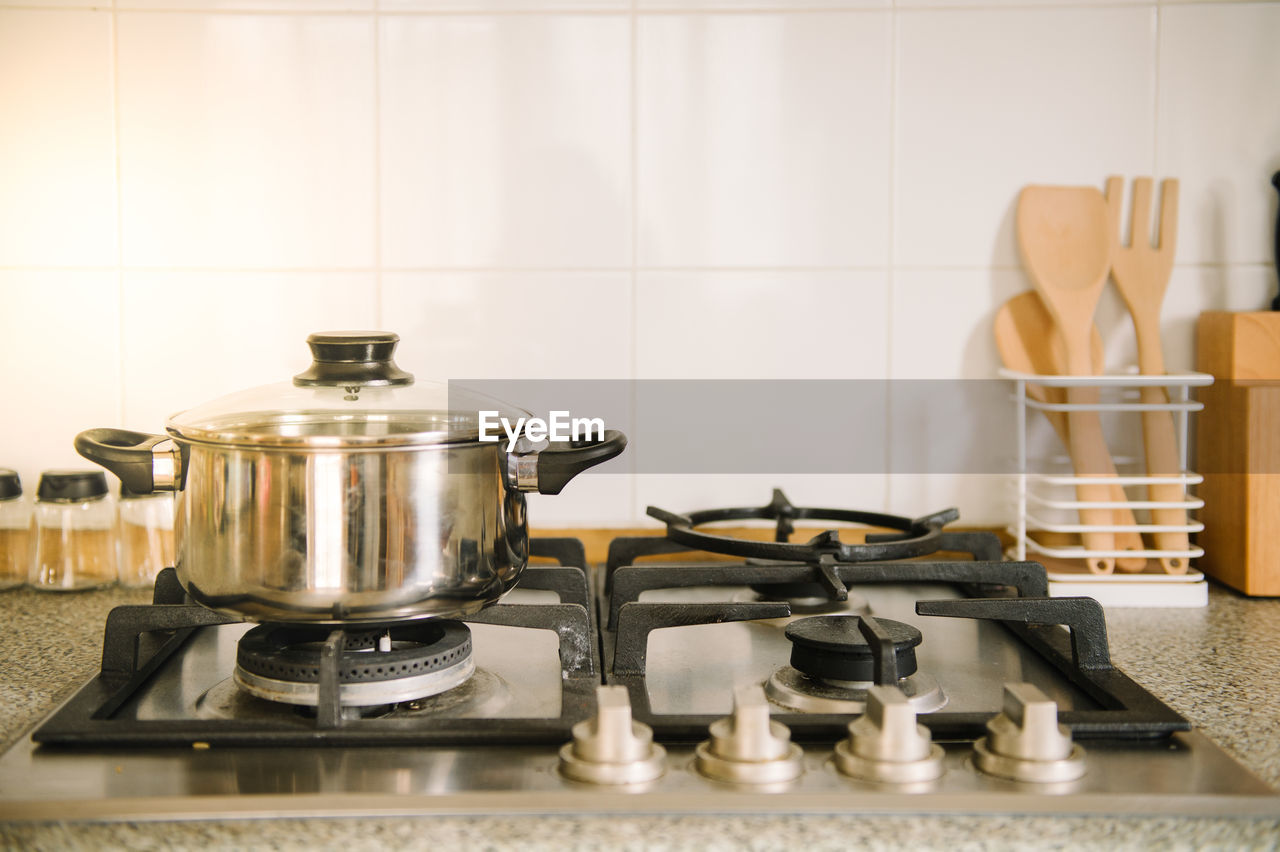 stove, kitchen, domestic kitchen, appliance, home, domestic room, burner - stove top, household equipment, indoors, kitchen utensil, cooking pan, no people, metal, still life, close-up, pan, preparation, home interior, saucepan, food and drink, gas stove burner, steel, silver colored