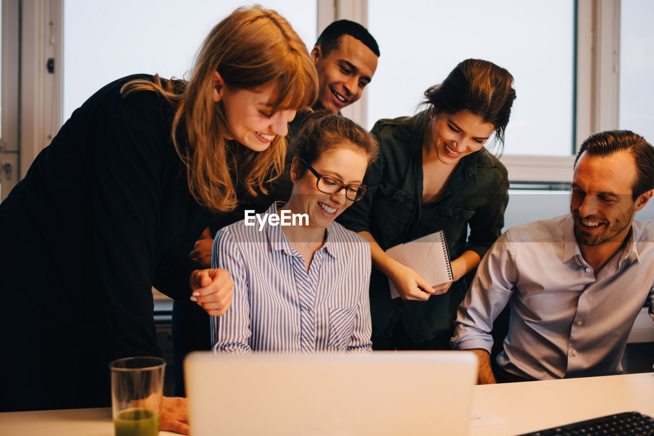group of people, office, women, adult, young adult, communication, young women, business, wireless technology, indoors, cooperation, business person, colleague, meeting, technology, businesswoman, togetherness, mid adult, teamwork, using laptop, coworker, brainstorming