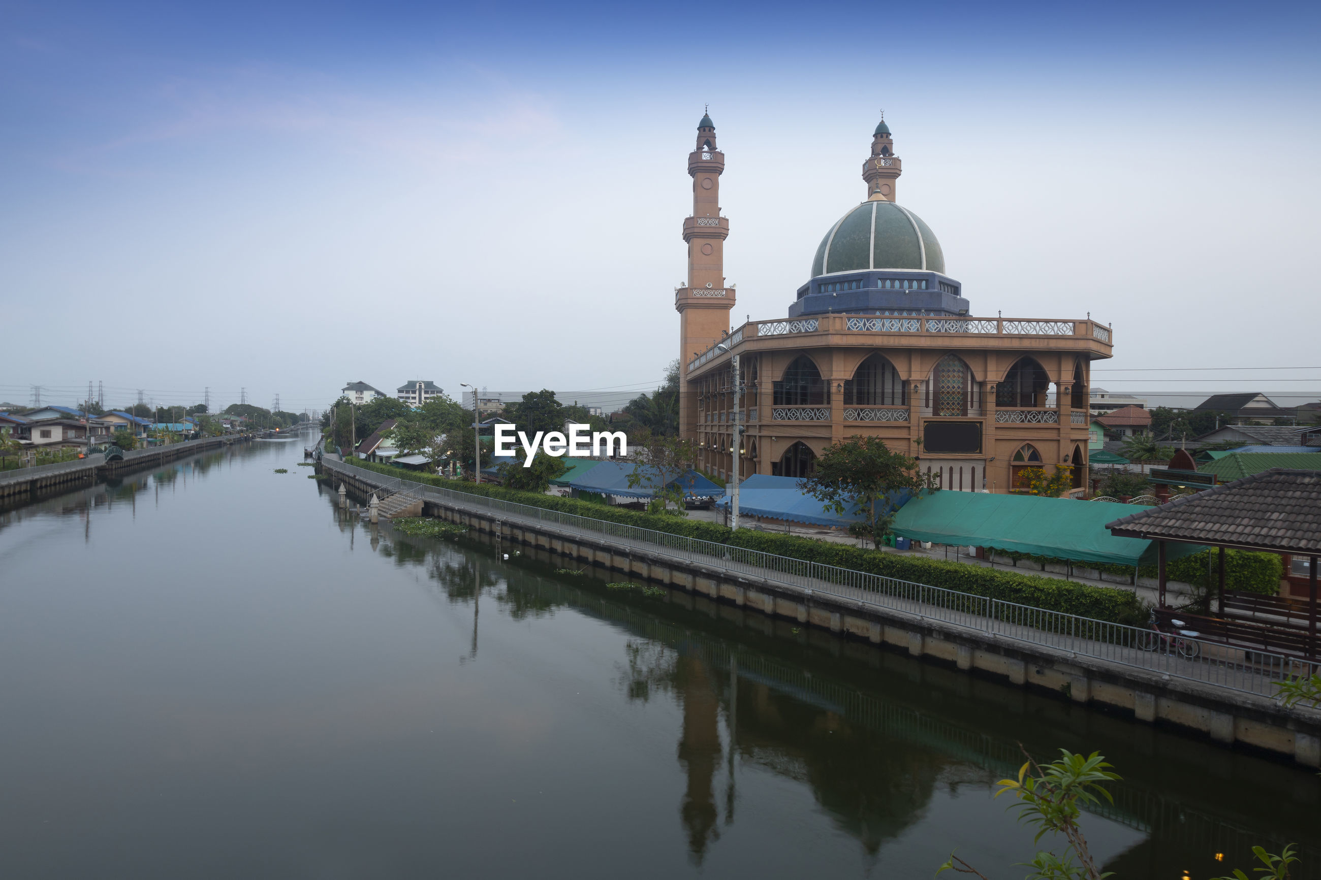 REFLECTION OF MOSQUE IN LAKE