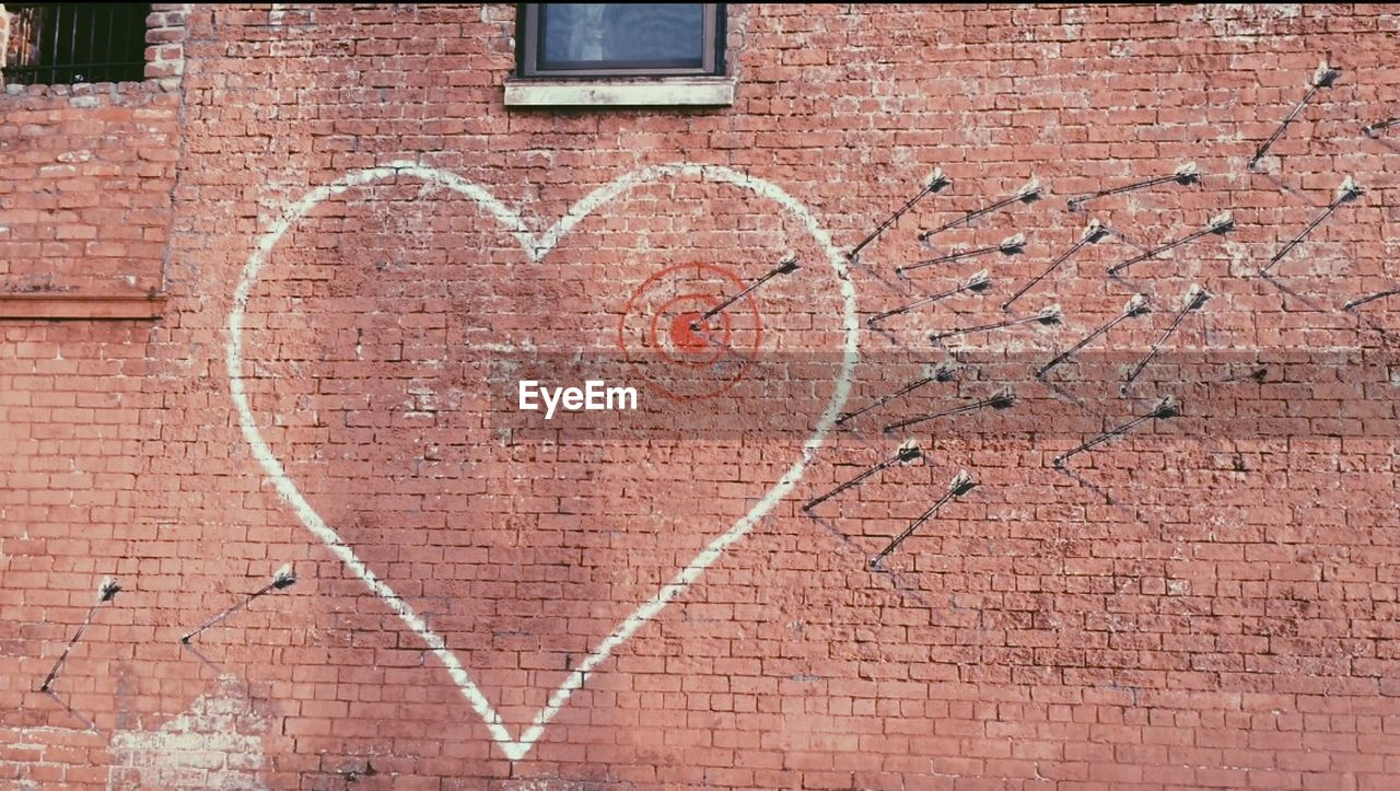 brick wall, architecture, heart shape, love, day, built structure, outdoors, no people, building exterior, brown, textured, close-up