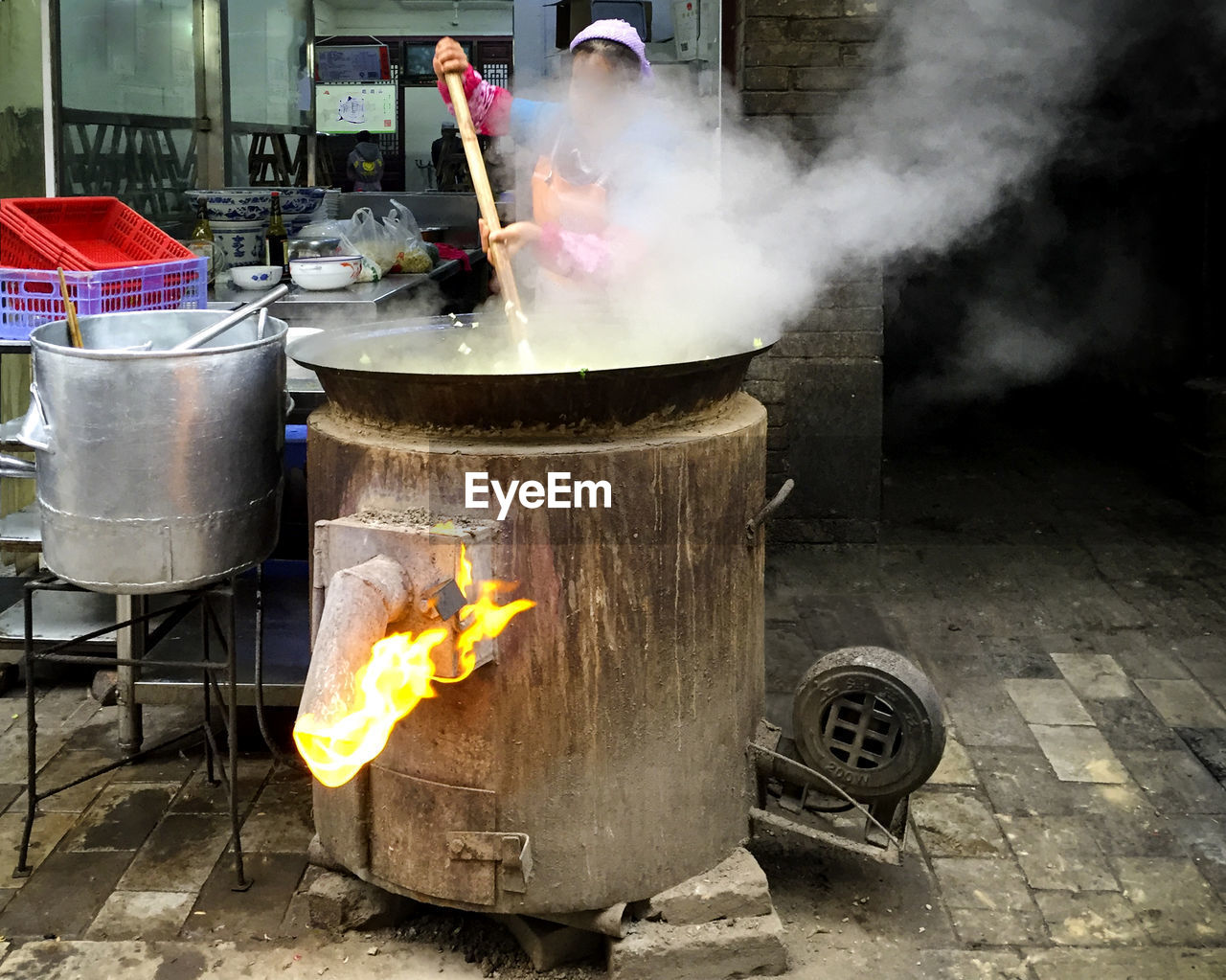 Woman cooking food in city