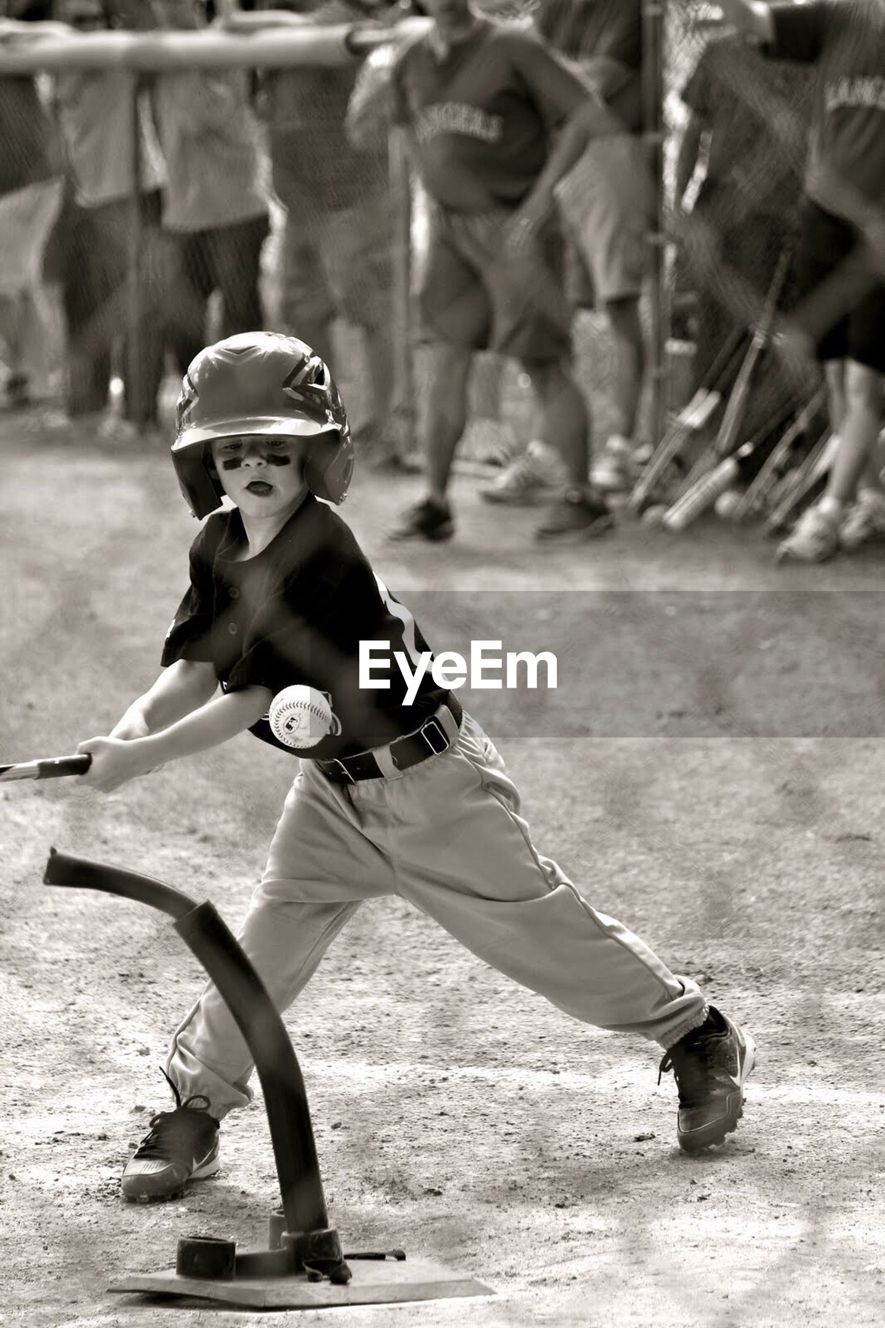 Full length of boy playing baseball