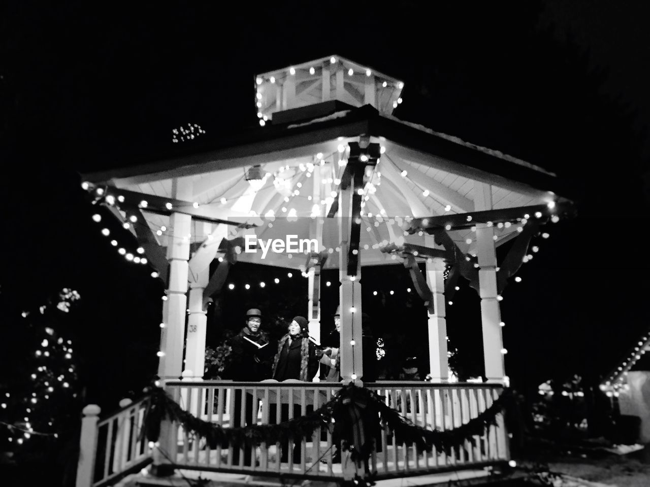 night, illuminated, amusement park, arts culture and entertainment, real people, low angle view, outdoors, amusement park ride, carousel, leisure activity, one person, lifestyles, sky, people