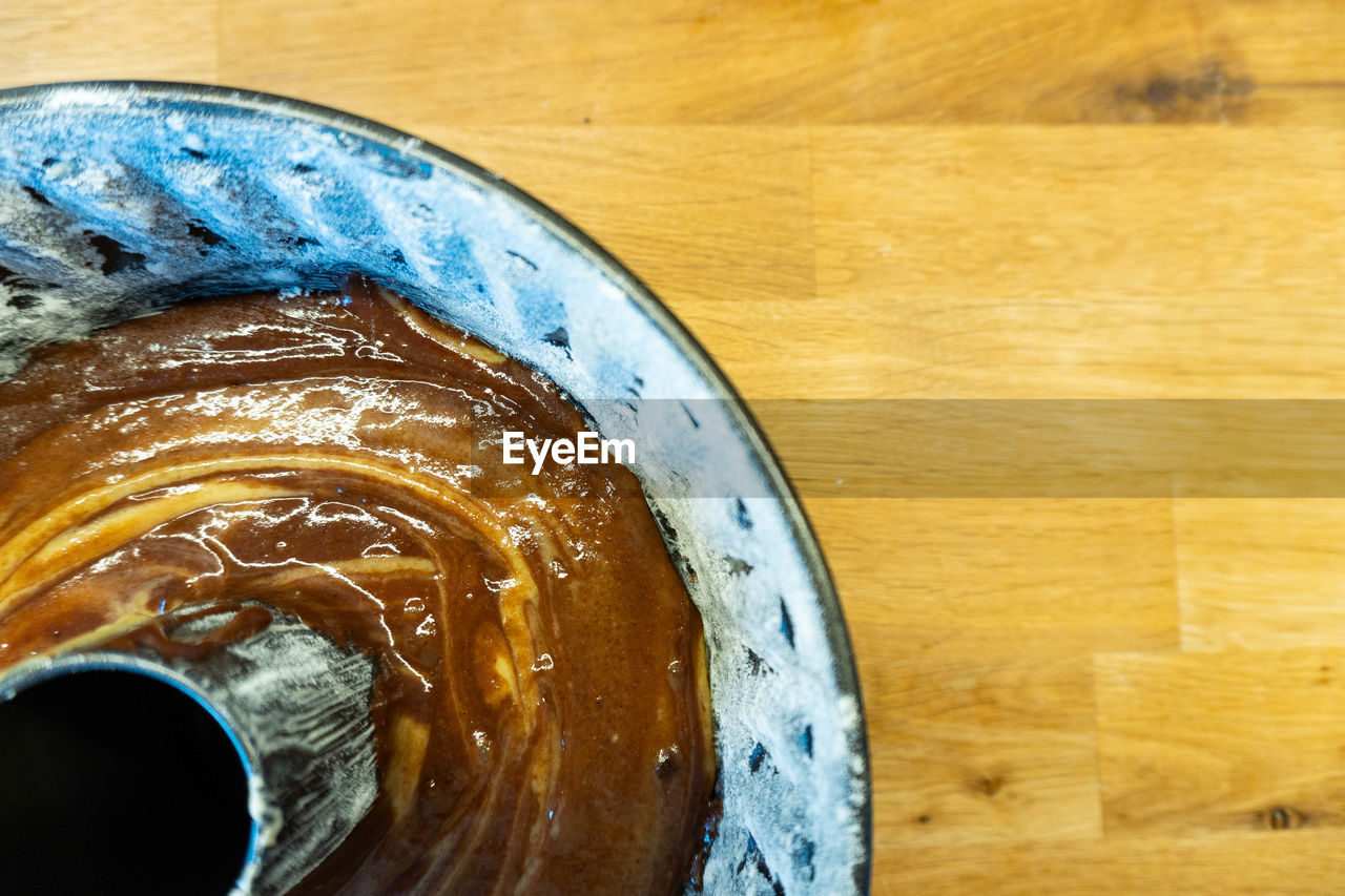 close-up, indoors, wood - material, food and drink, table, no people, refreshment, still life, drink, freshness, directly above, high angle view, food, coffee, coffee - drink, brown, wellbeing, focus on foreground, household equipment, healthy eating, glass, non-alcoholic beverage