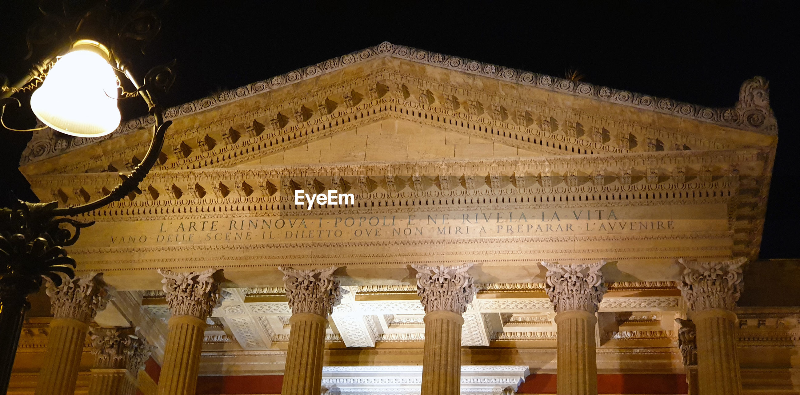 Low angle view of illuminated building at night. massimo theatre in palermo
