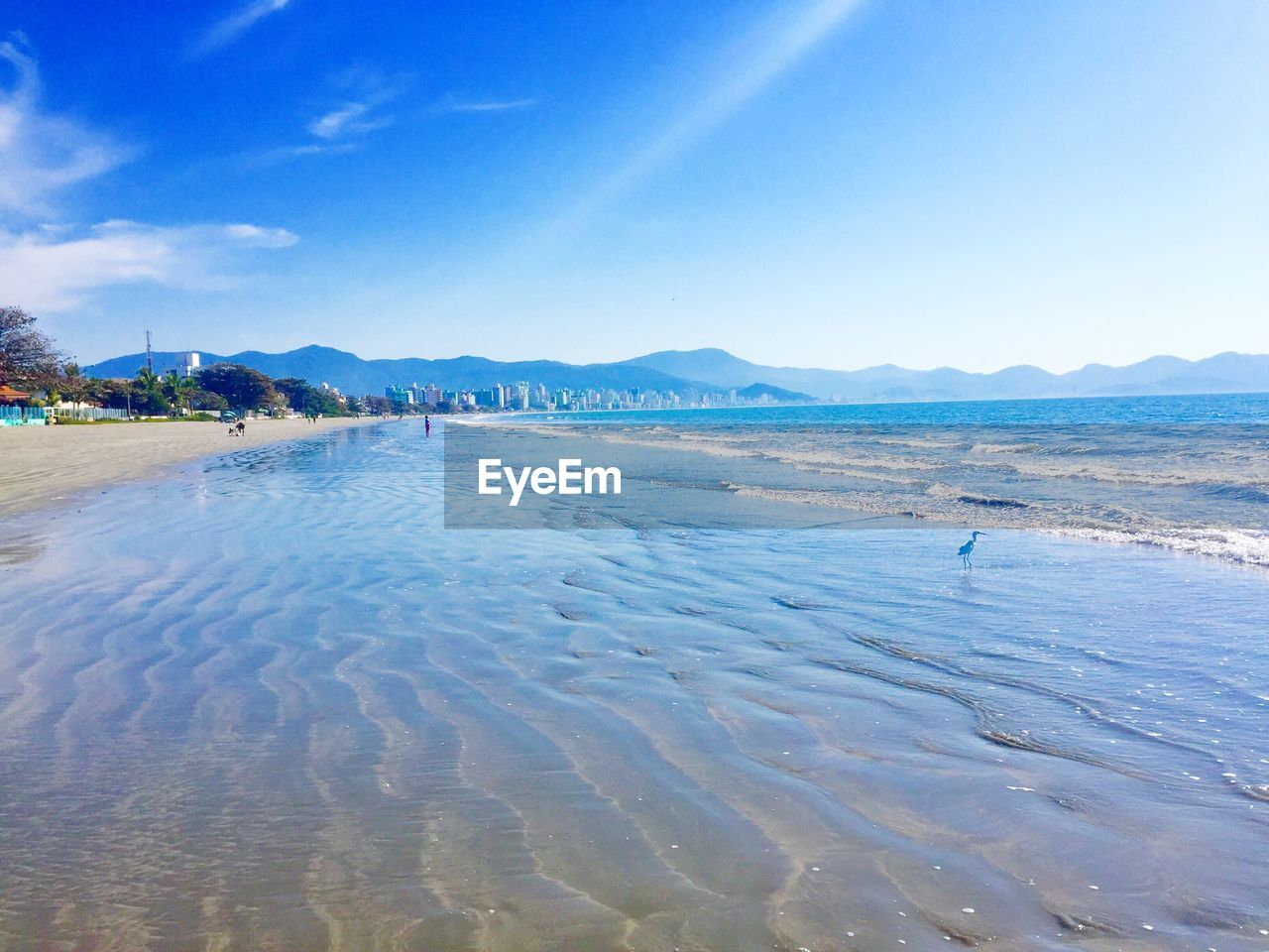sea, beach, water, scenics, beauty in nature, nature, sky, tranquil scene, tranquility, blue, sand, outdoors, day, vacations, summer, travel destinations, landscape, mountain, no people, wave