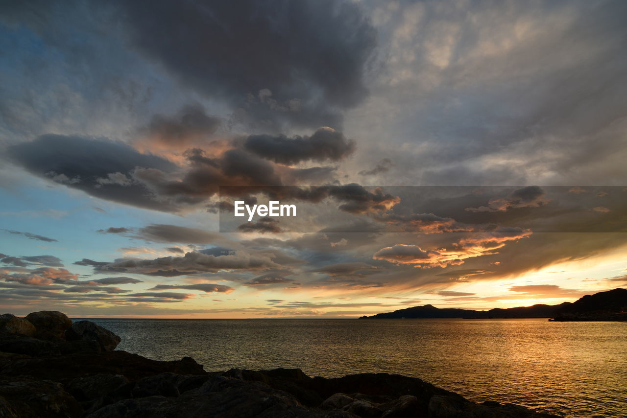 sky, cloud - sky, water, scenics - nature, beauty in nature, sunset, sea, tranquil scene, tranquility, rock, horizon, horizon over water, rock - object, solid, nature, no people, idyllic, non-urban scene, outdoors