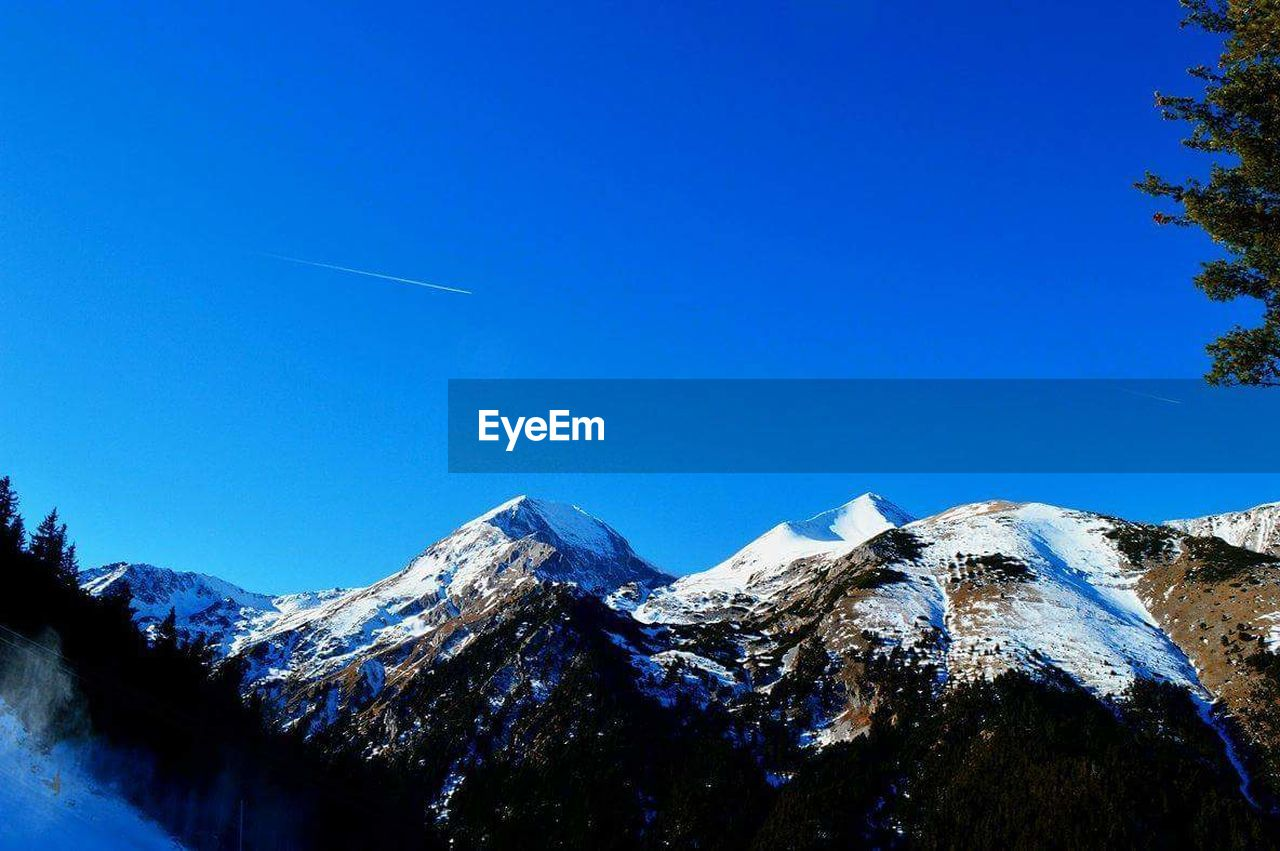 mountain, snow, mountain range, nature, cold temperature, snowcapped mountain, blue, scenics, winter, mountain peak, beauty in nature, day, no people, sky, outdoors, clear sky, travel destinations, vapor trail, landscape, tree