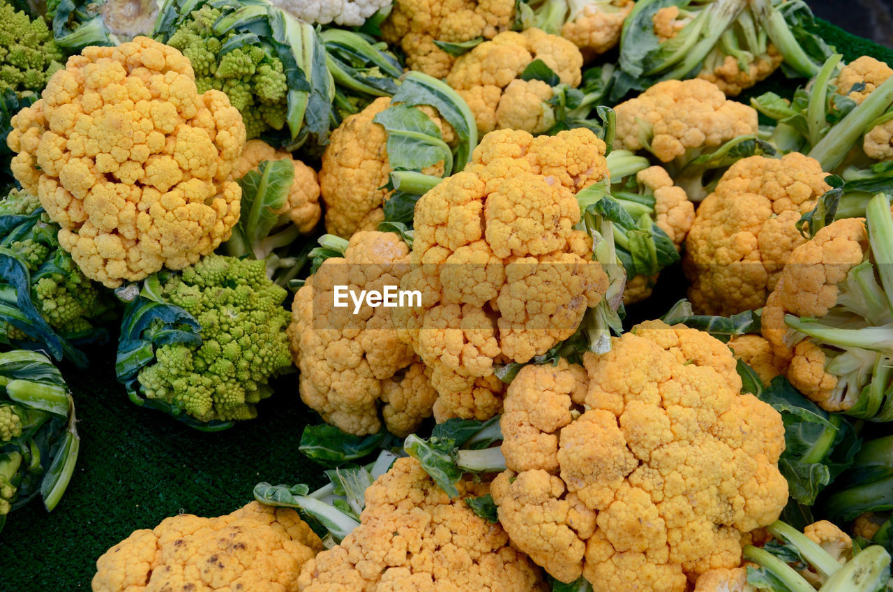 food and drink, healthy eating, food, cauliflower, freshness, wellbeing, vegetable, large group of objects, no people, market, green color, close-up, retail, indoors, market stall, raw food, abundance, full frame, still life, for sale