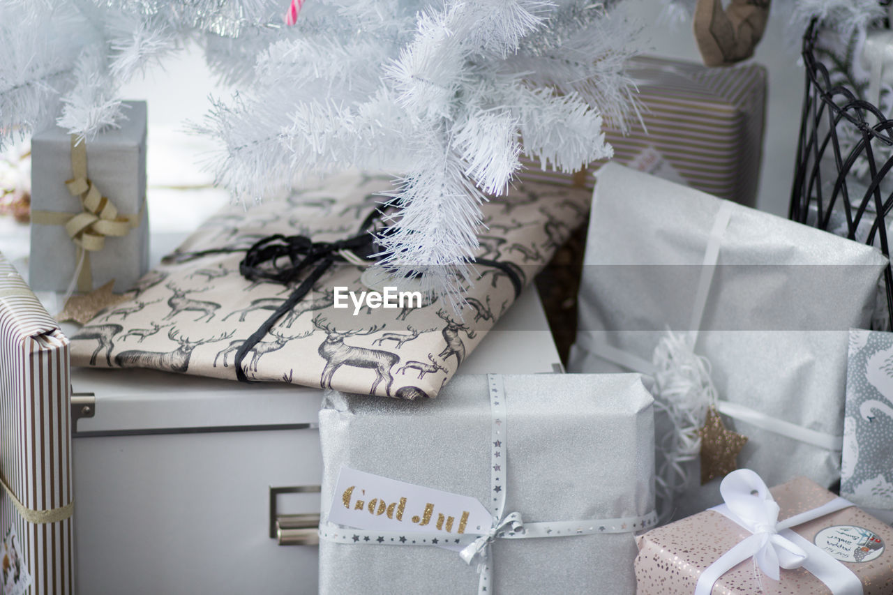 celebration, indoors, christmas, no people, gift, decoration, holiday, close-up, box, still life, box - container, text, ribbon - sewing item, white color, ribbon, gift box, tied bow, bow, event, christmas ornament, softness