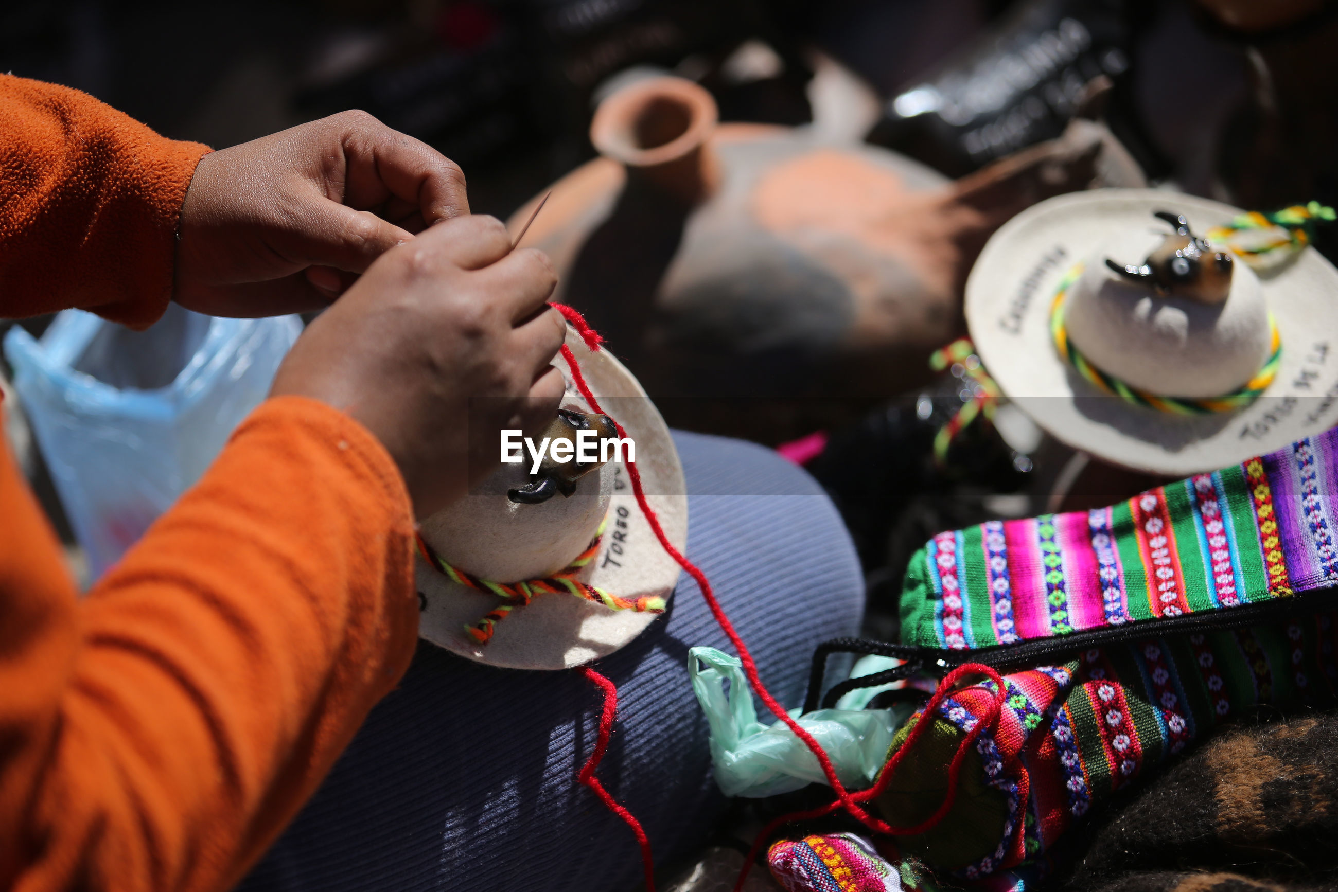 Midsection of woman making art product for sale