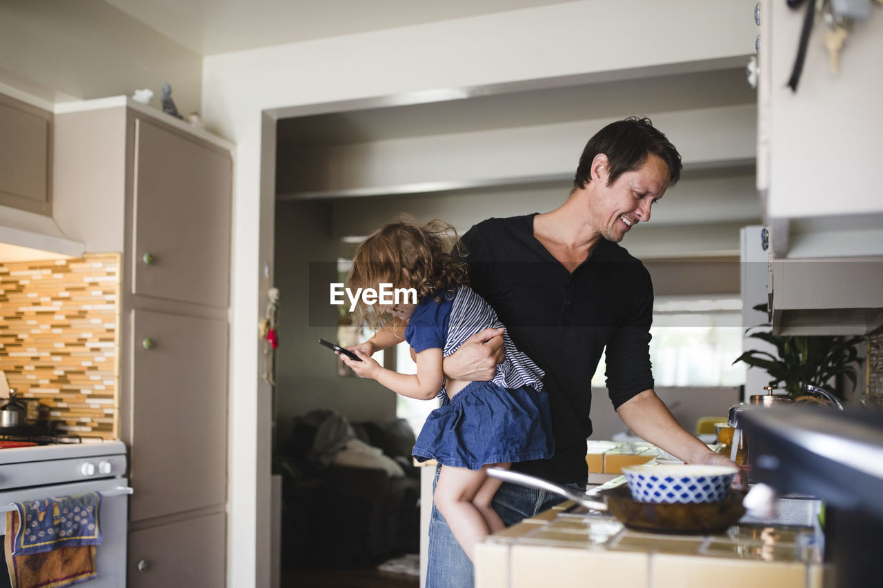 FATHER AND SON IN KITCHEN AT HOME