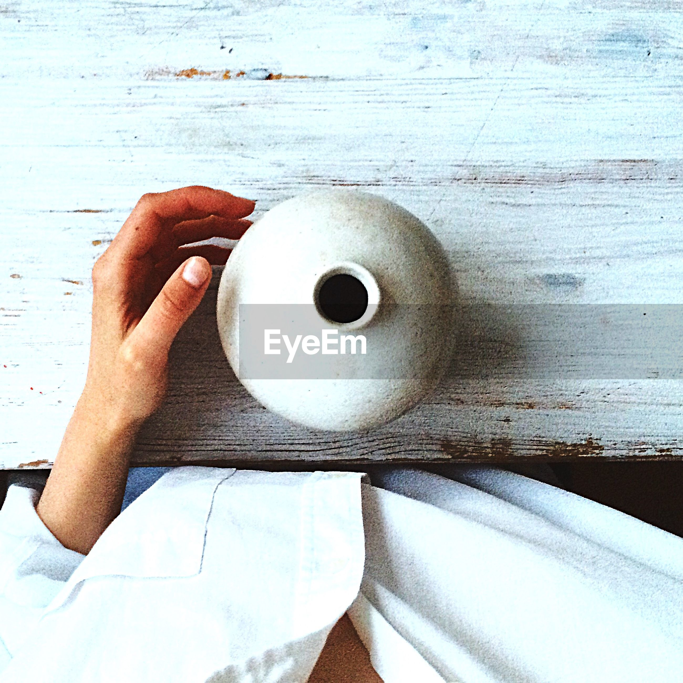 indoors, part of, high angle view, person, directly above, close-up, coffee cup, wood - material, personal perspective, holding, cropped, white color, food and drink, table, still life, coffee - drink, unrecognizable person